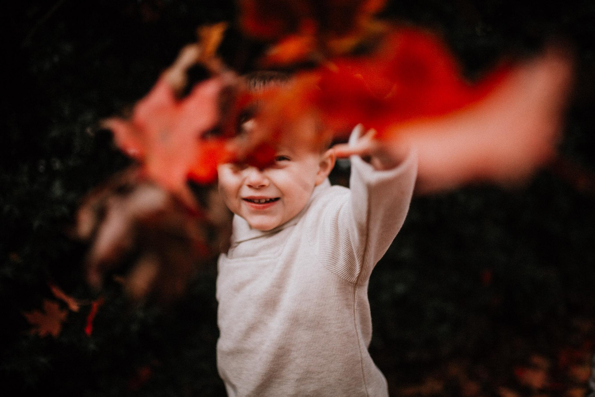 toddler boy throw leaves fall autumn lifestyle documentary family Historic Old Town Manassas Virginia Marti Austin Photography