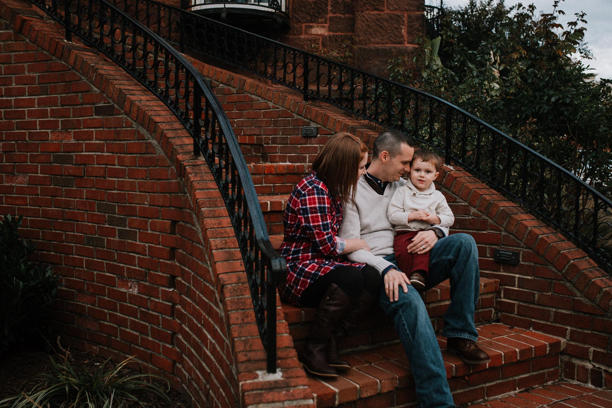 family of three brick stairs mother father son fall autumn lifestyle documentary family Historic Old Town Manassas Virginia Marti Austin Photography