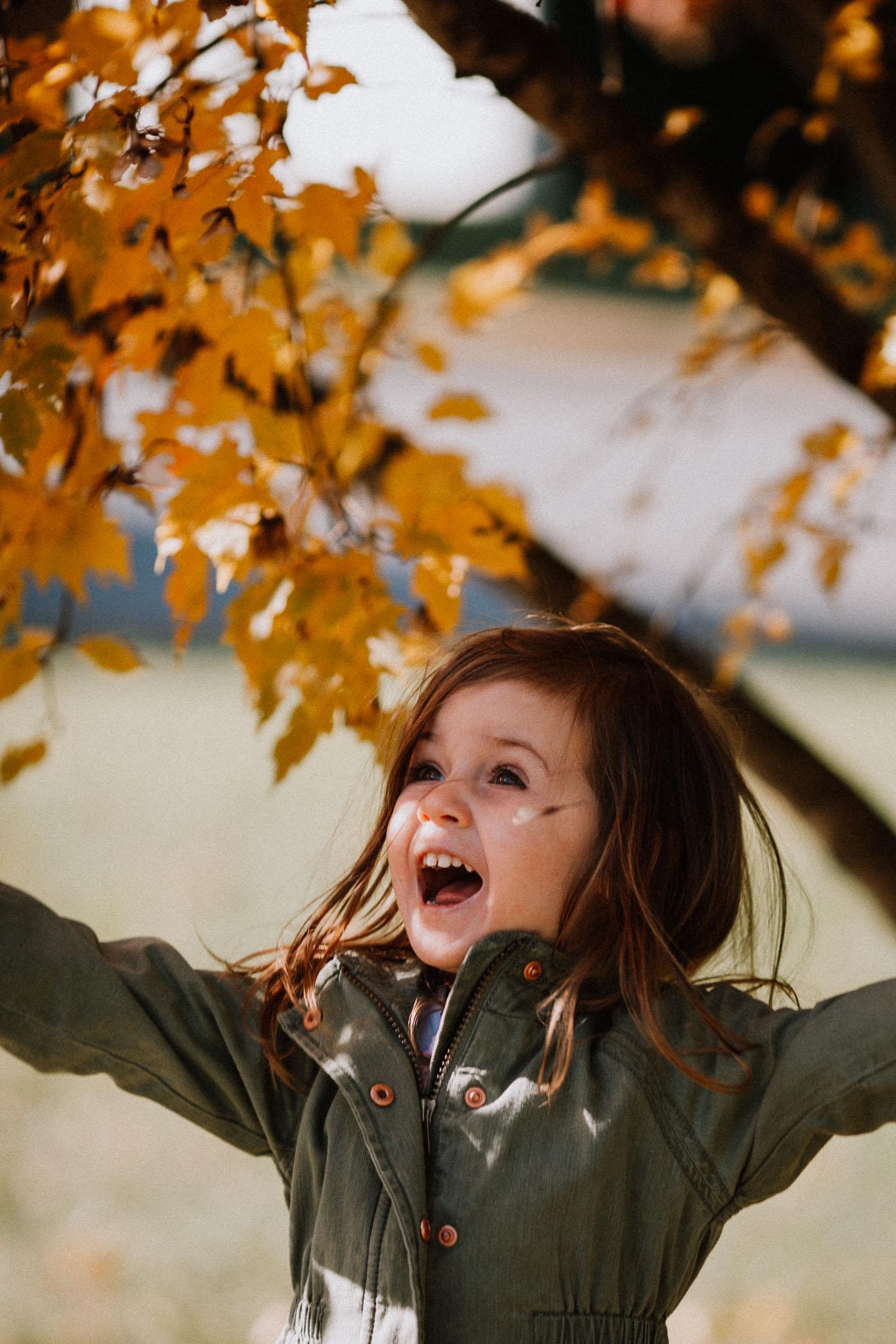 toddler girl green coat yellow leaves  fall Ashburn Loudoun Virginia Lifestyle Documentary Family Marti Austin Photography