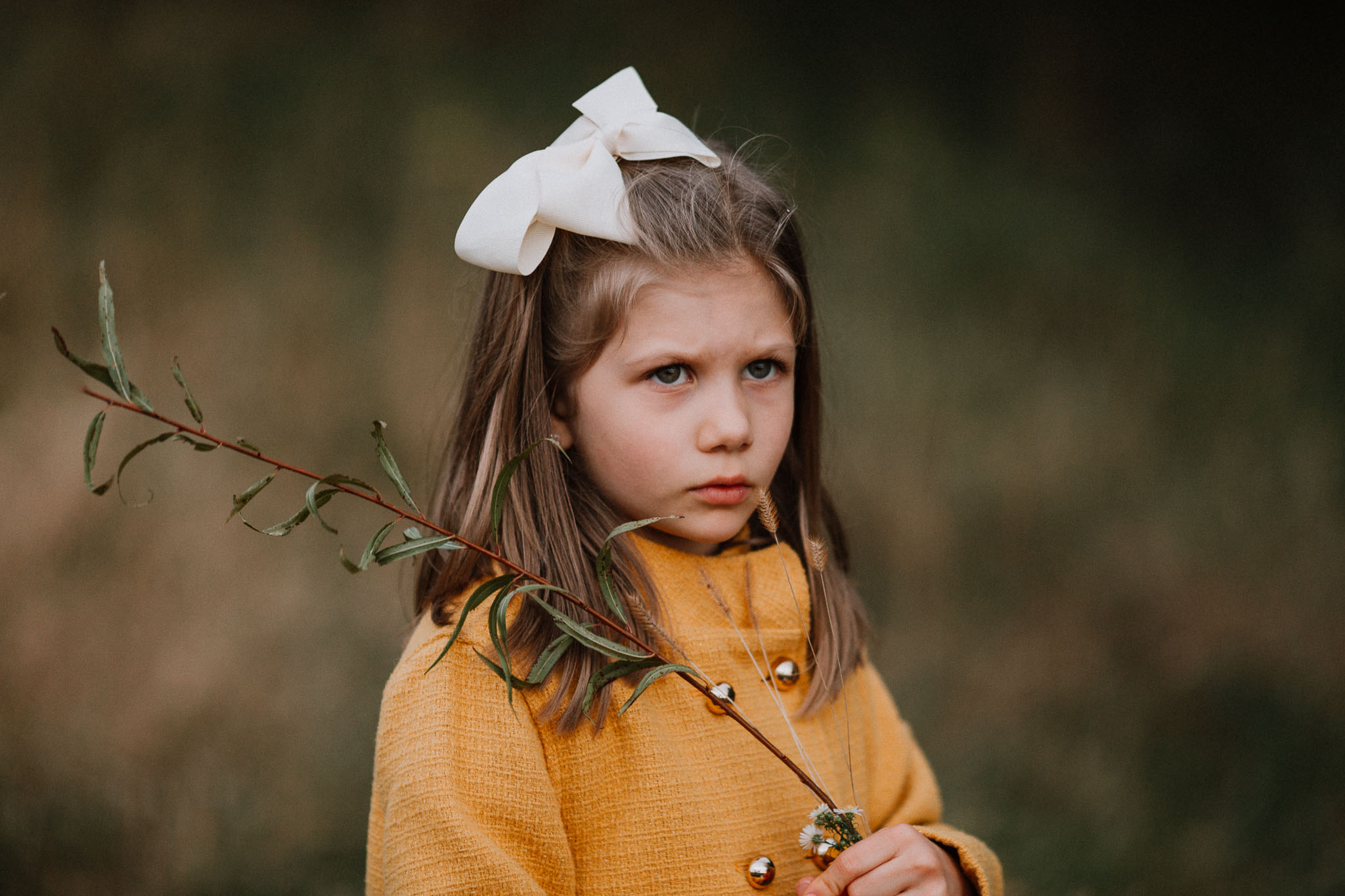 girl yellow bow portrait fall autumn family lifestyle documentary Heritage Farm Museum Claude Moore Park Sterling Virginia Marti Austin Photography