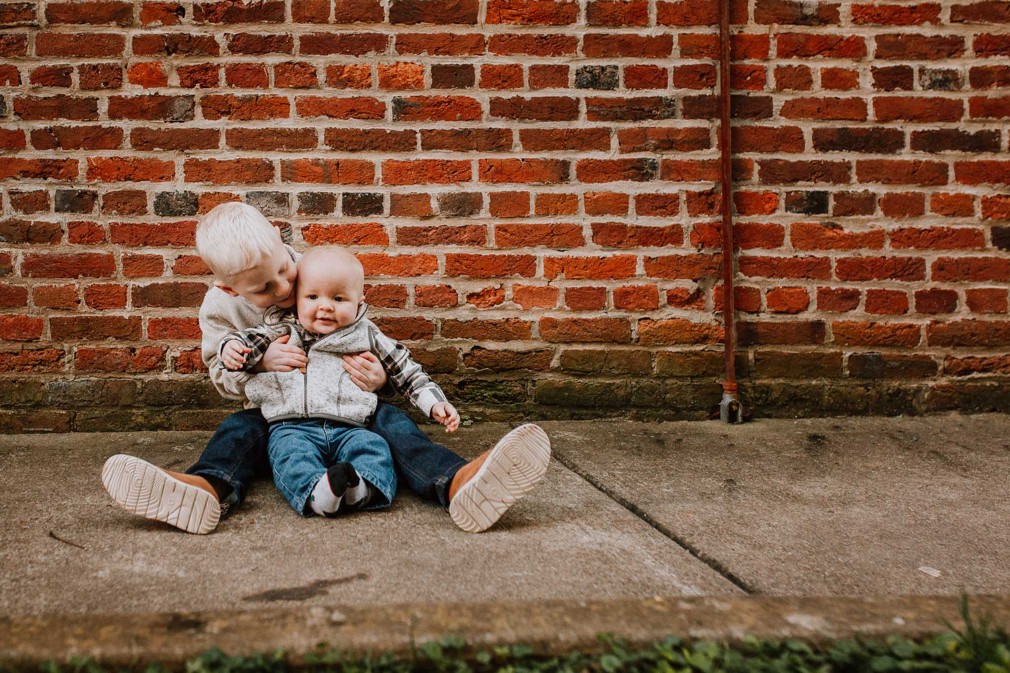 brothers siblings brick wall fall autumn lifestyle documentary family Historic Downtown Leesburg Loudoun Virginia Marti Austin Photography