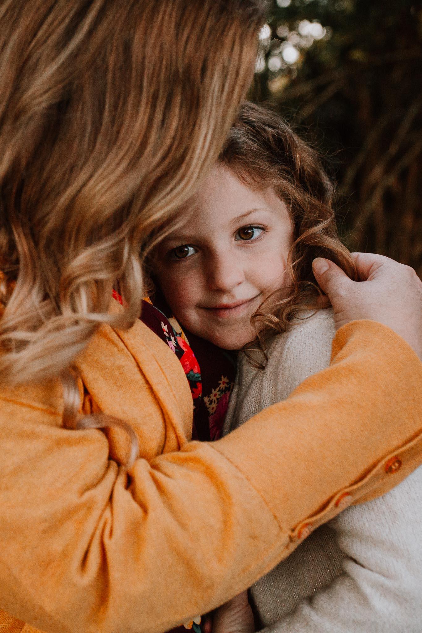 mother daughter hug family lifestyle documentary Morven Park Leesburg Loudoun Virginia Fall Autumn Marti Austin Photography