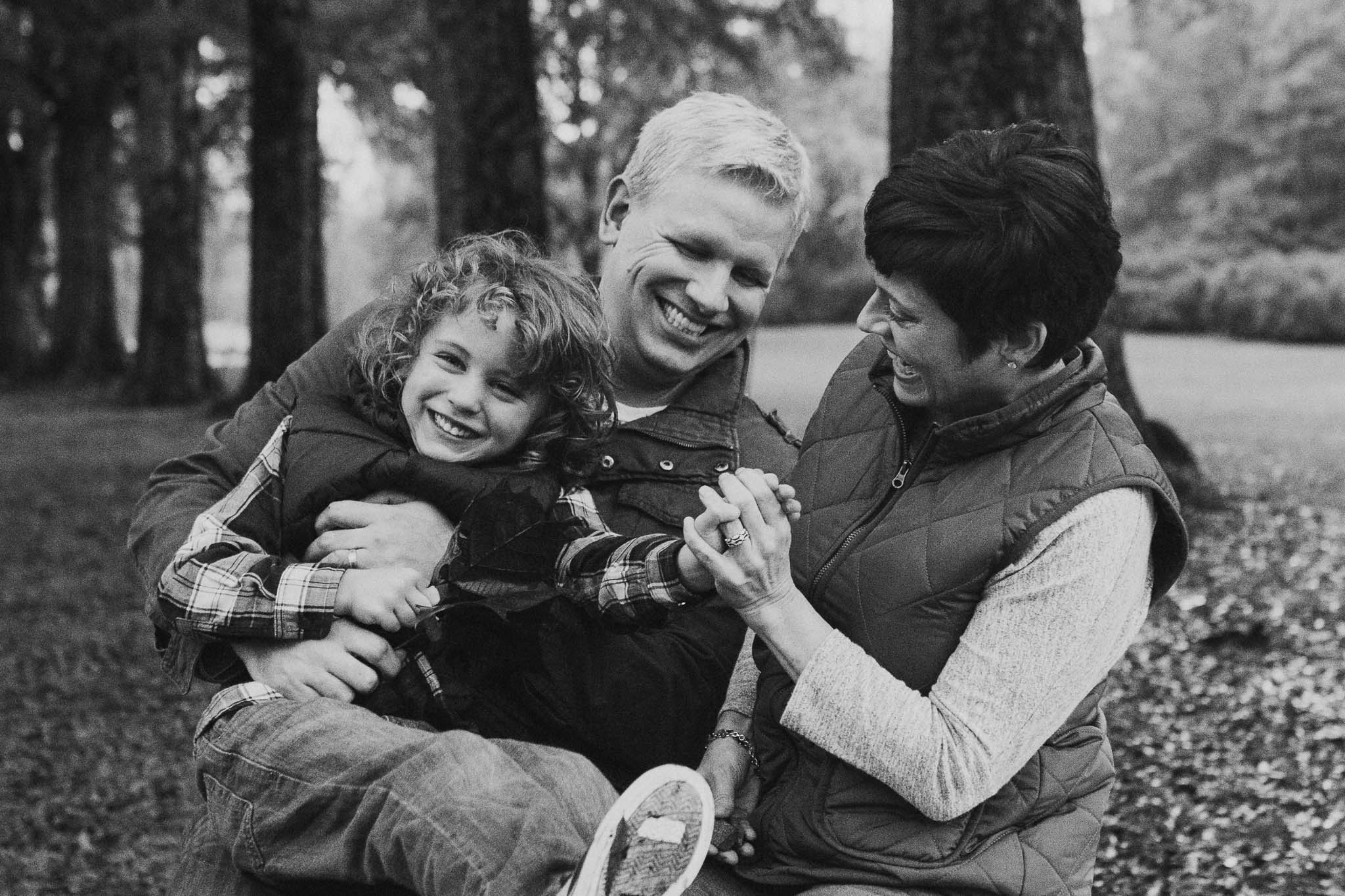 Black and white family of three laughing tickling fall autumn family lifestyle documentary Morven Park Leesburg Loudoun Virginia Marti Austin Photography