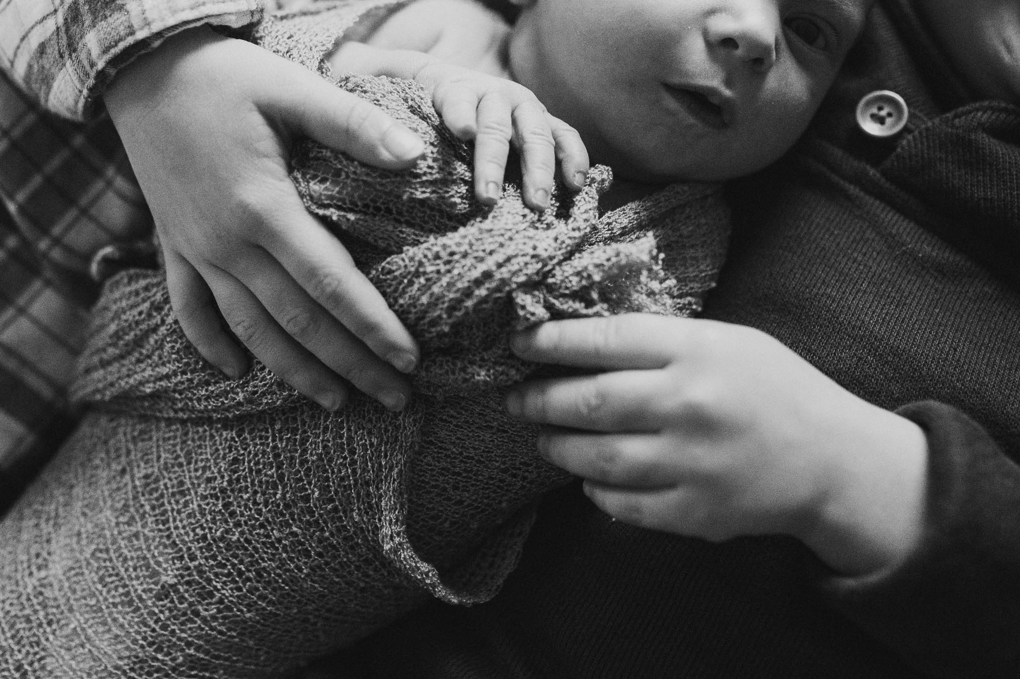 black and white baby boy hands details siblings brother sister  lifestyle documentary in home family newborn ashburn loudoun virginia Marti Austin Photography