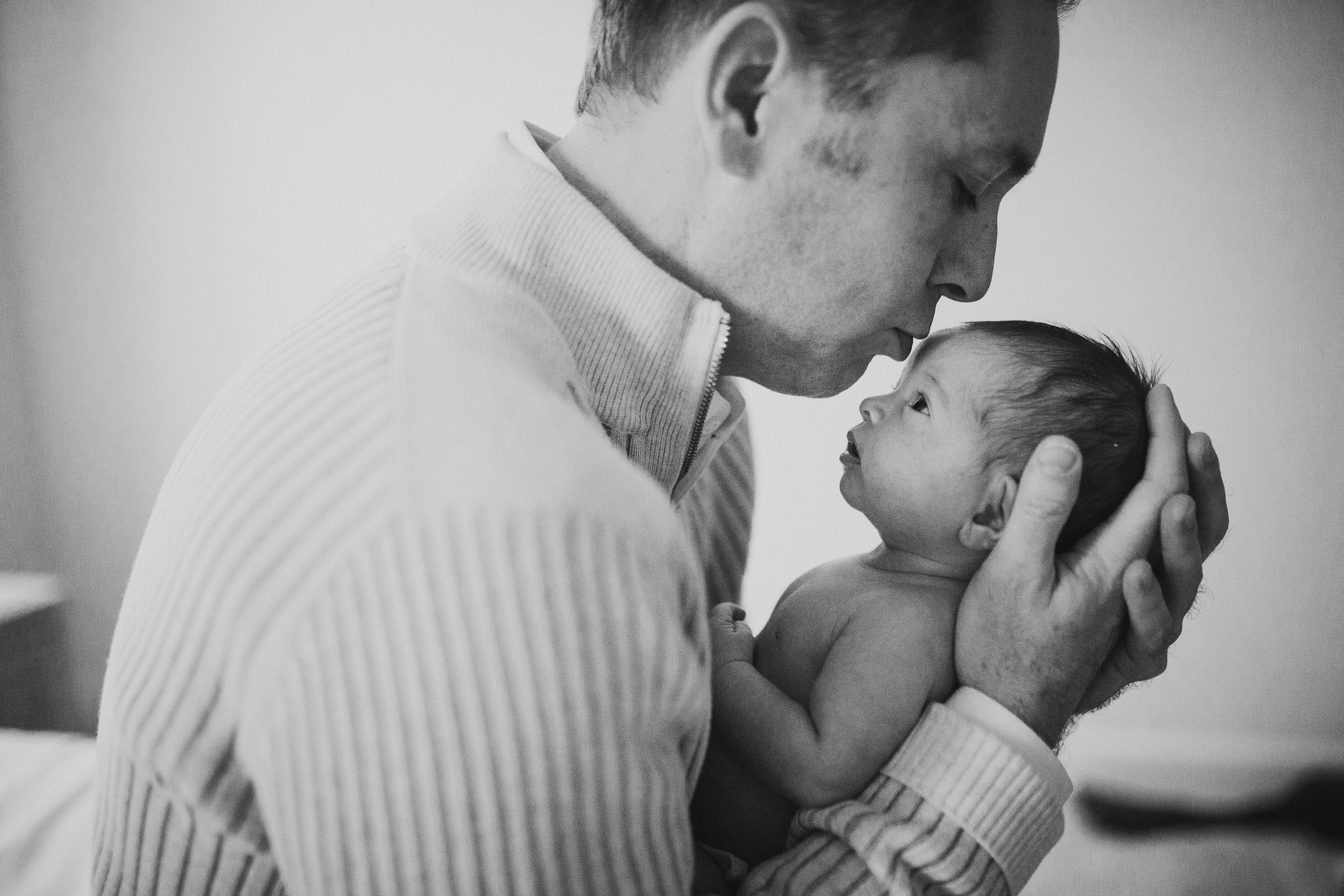 Black and white father daughter hands details kiss newborn baby girl lifestyle documentary Ashburn Loudoun Virginia Marti Austin Photography