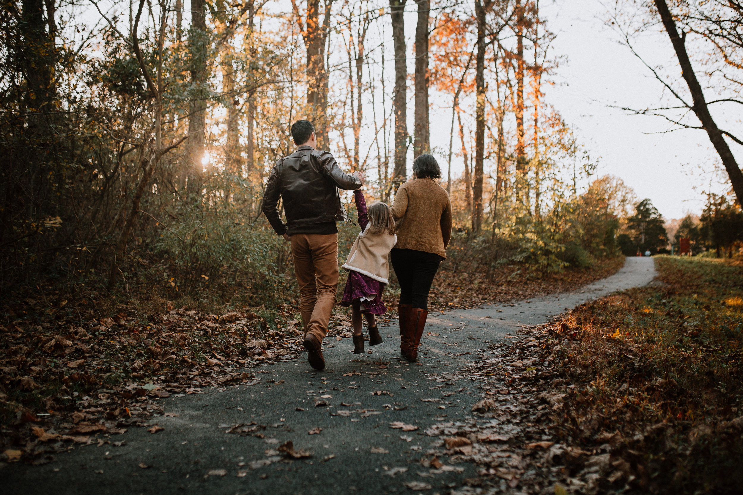 family of three walk swing forest path lifestyle family documentary fall autumn sunset golden Cabell's Mill Ellanor C Lawrence Chantilly Virginia Marti Austin Photography