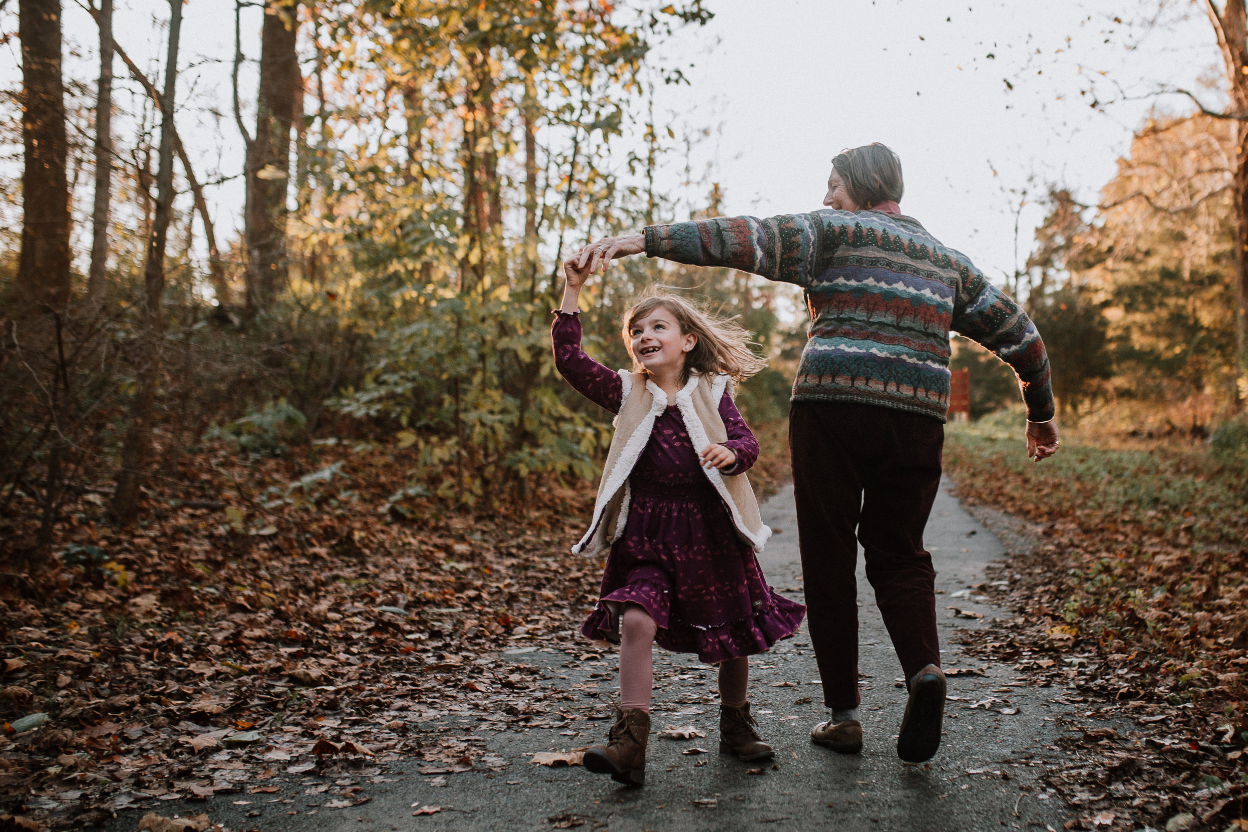 grandmother granddaughter walk twirl forest path lifestyle family documentary fall autumn sunset golden Cabell's Mill Ellanor C Lawrence Chantilly Virginia Marti Austin Photography