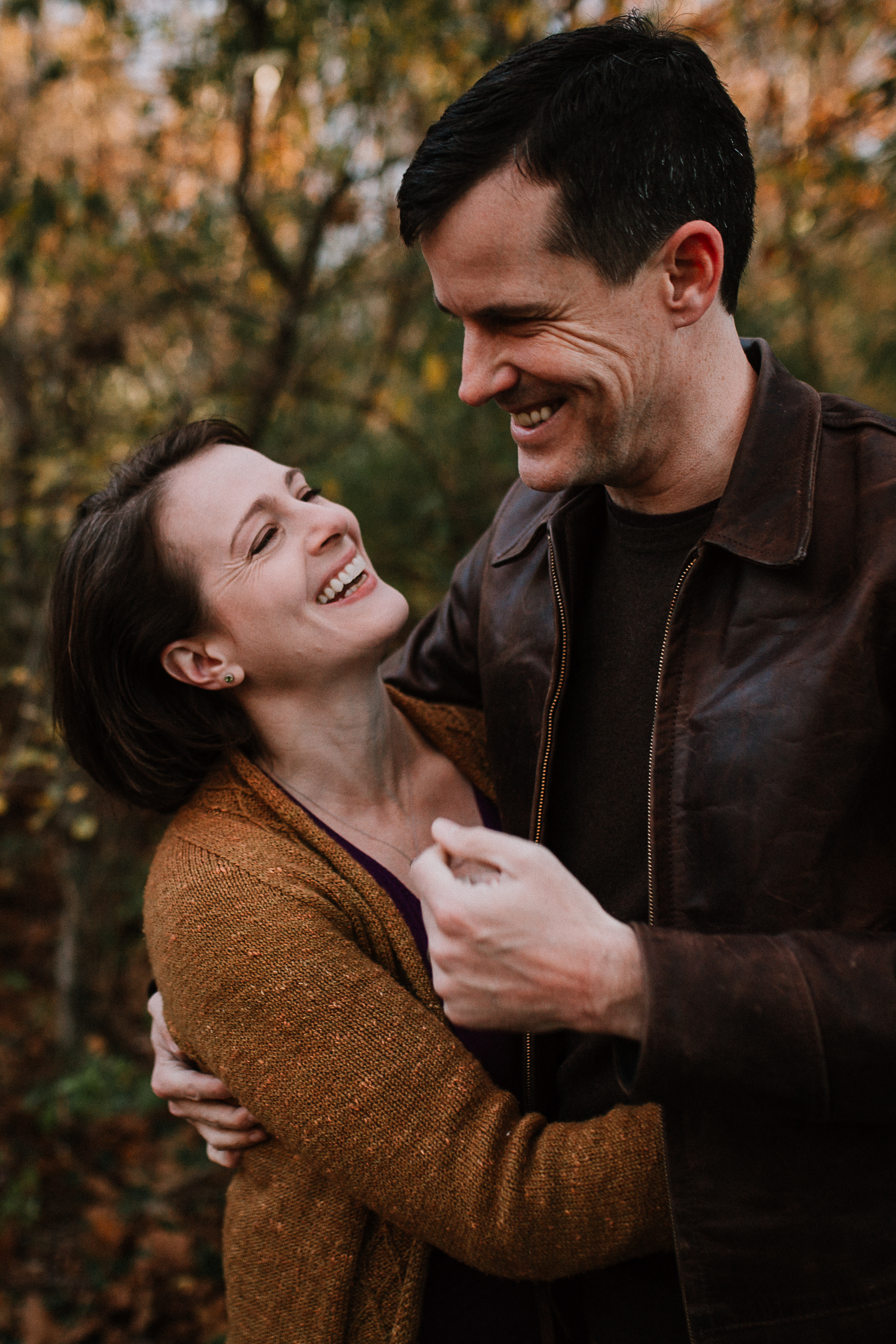 mother father couple hug laugh lifestyle family documentary fall autumn sunset golden Cabell's Mill Ellanor C Lawrence Chantilly Virginia Marti Austin Photography