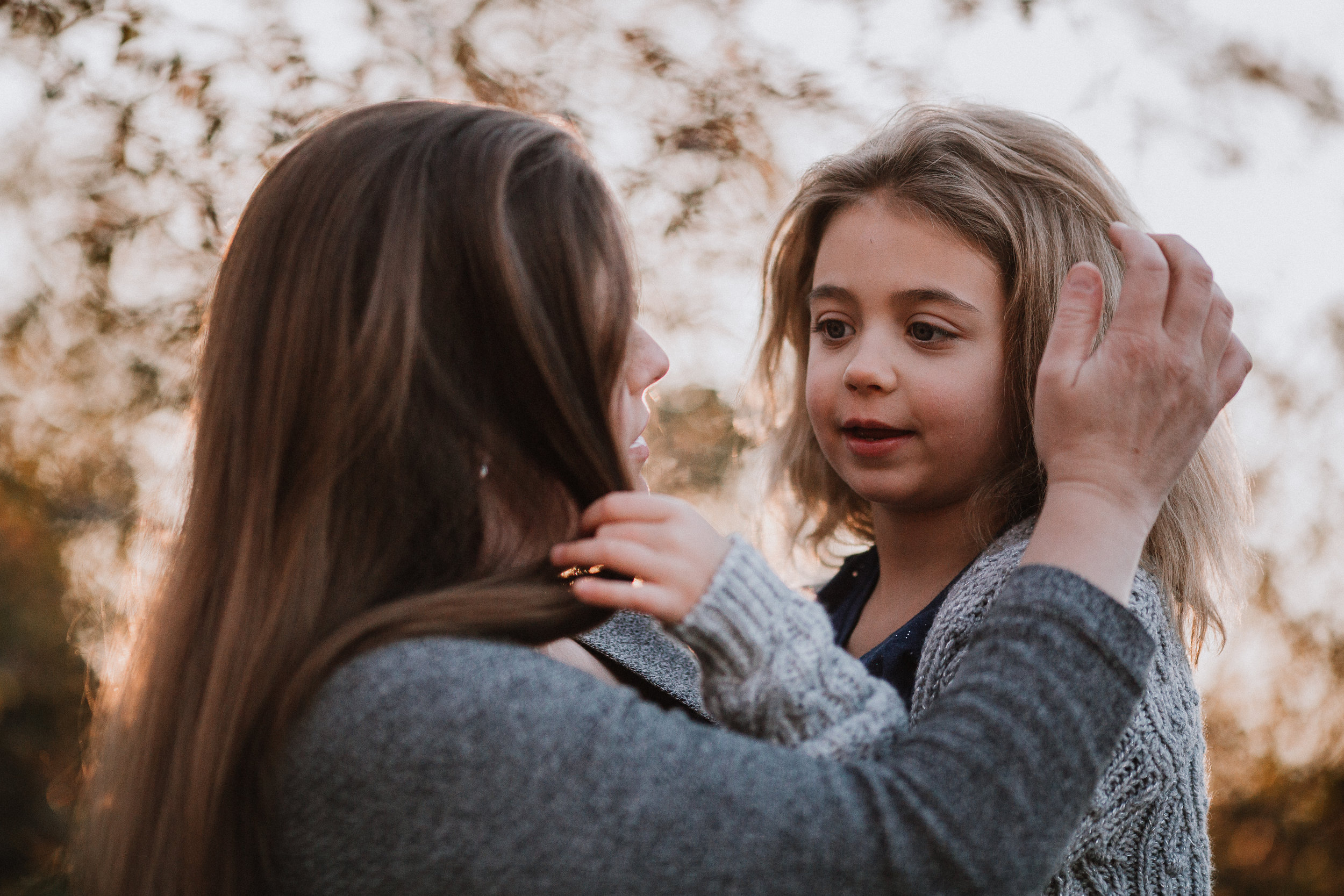mother daughter hug hands hair fall autumn outdoor lifestyle documentary Rust Nature Sanctuary Leesburg Loudoun Virginia Marti Austin Photography