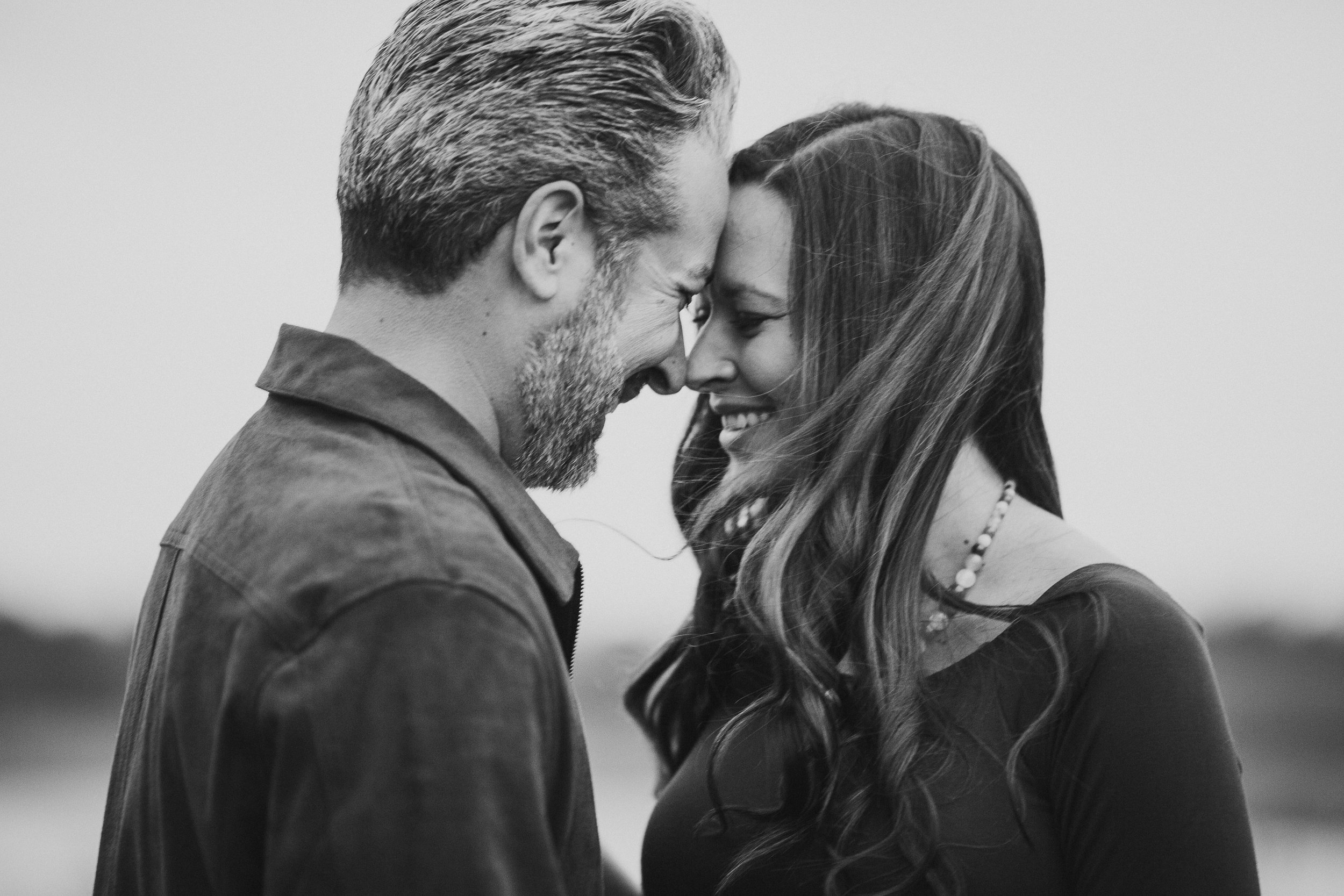 Black and white couple pregnancy laugh fall autumn sunset lifestyle documentary maternity couple family Aldie Willowsford Boat House Loudoun Virginia Marti Austin Photography
