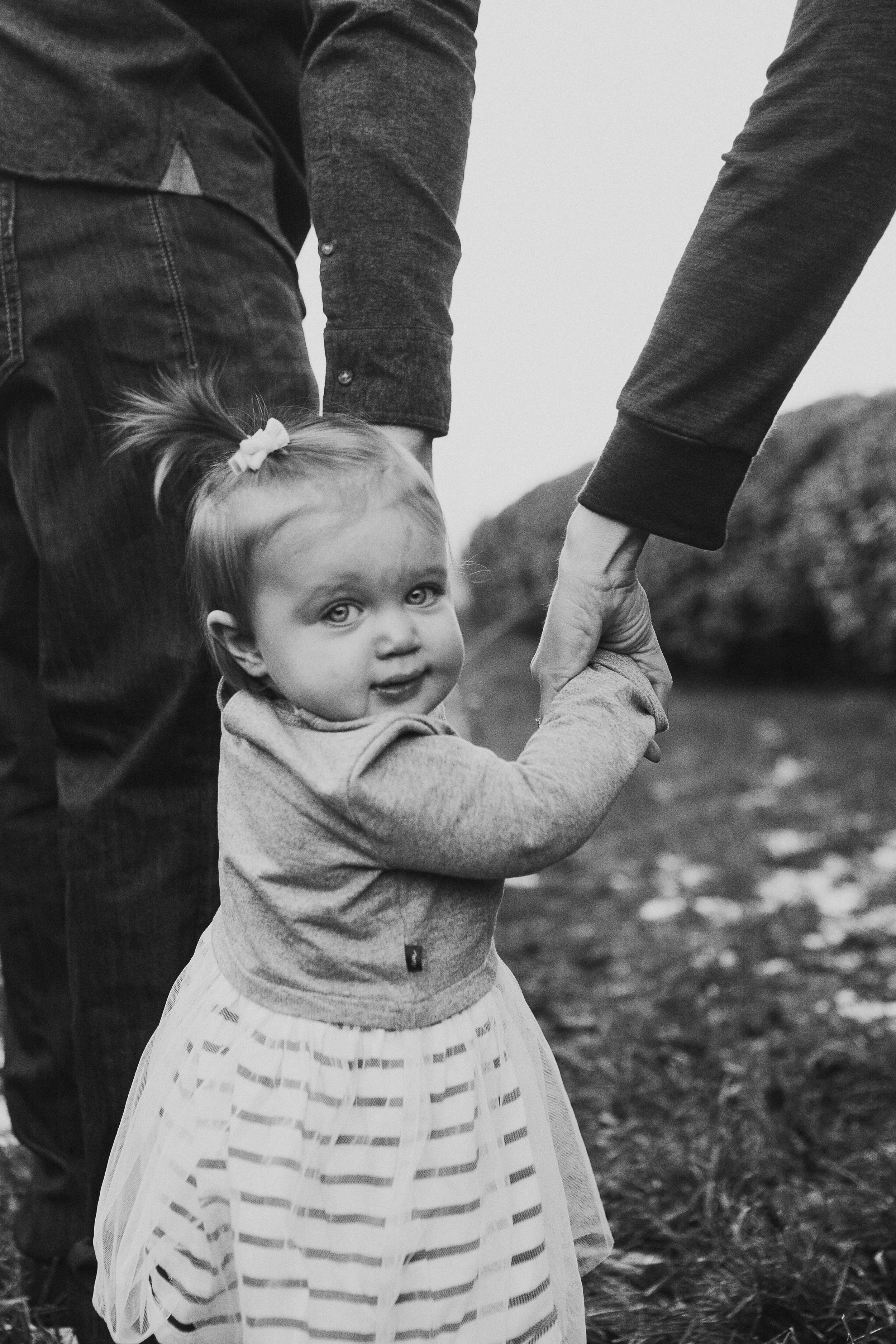 black and white toddler portrait hold hands Lifestyle Documentary Fall Autumn Sunset Golden Hour Family toddler first birthday cake smash Beaverdam Run Broadlands Loudoun Virginia Marti Austin Photography