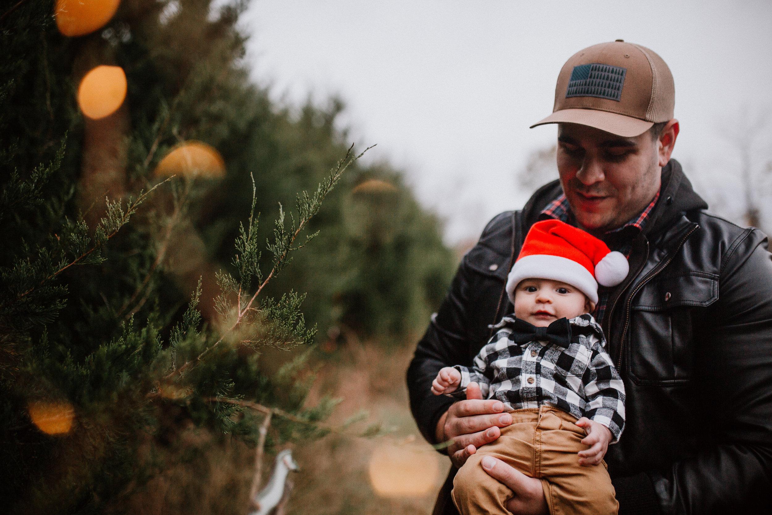 father son baby boy santa hat bokeh Christmas Holiday Lifestyle Documentary Family Ashburn Loudoun Virginia Marti Ausitn Photography