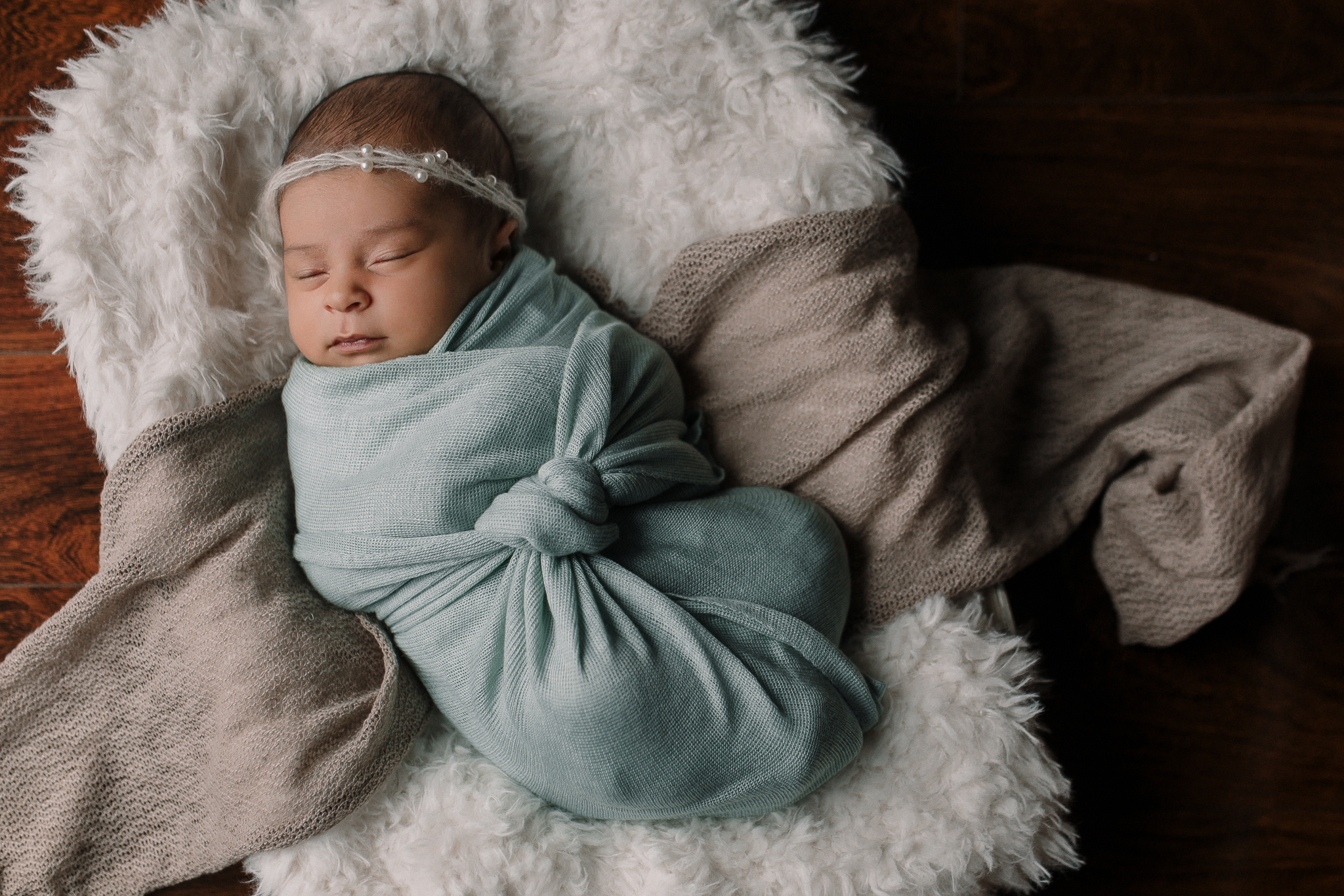 newborn baby girl portrait blue brown white headband in home lifestyle documentary newborn baby girl family Aldie Loudoun Virginia Marti Austin Photography