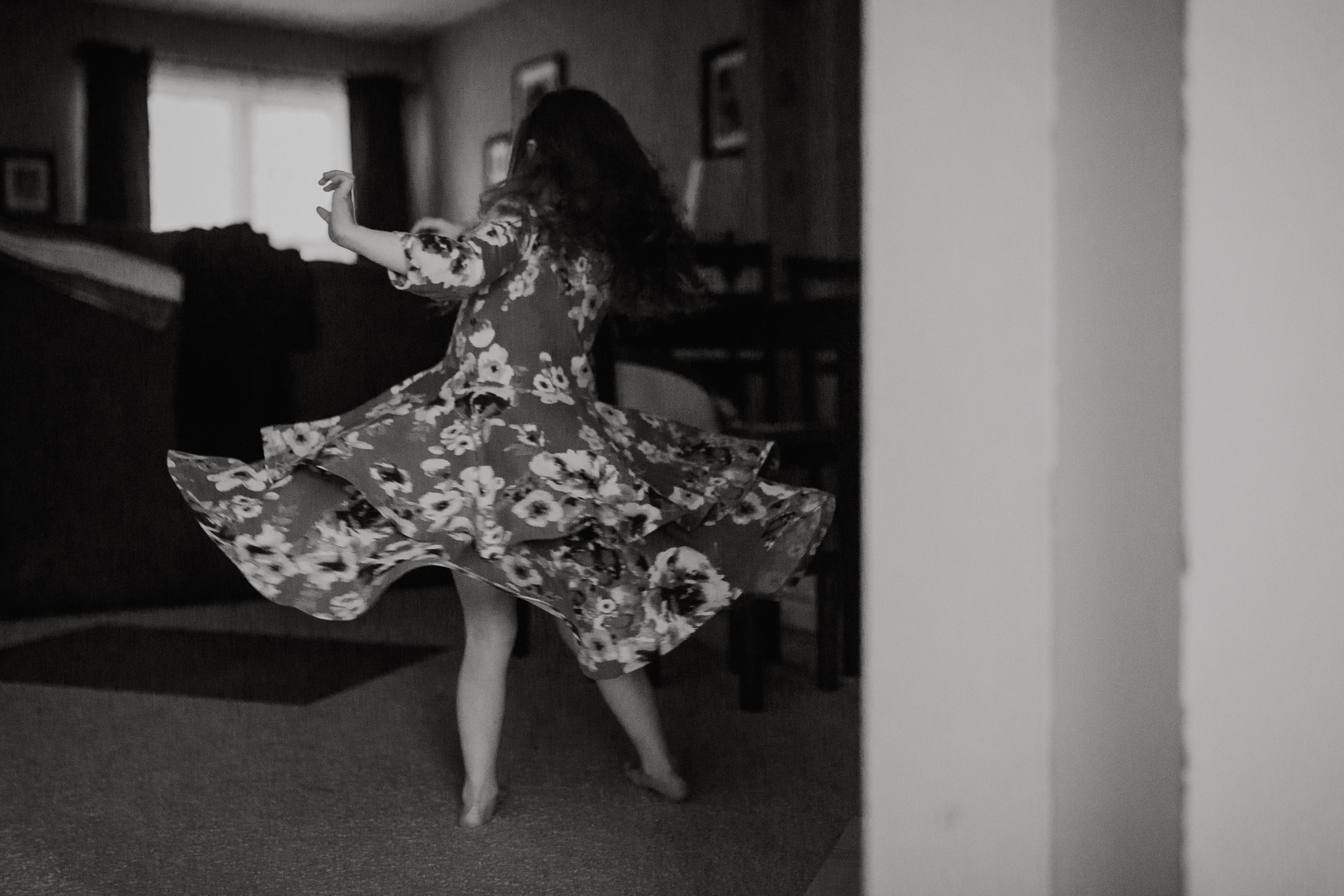 Black and white childhood girl dress twirl lifestyle documentary movement Ashburn Virginia Marti Austin Photography