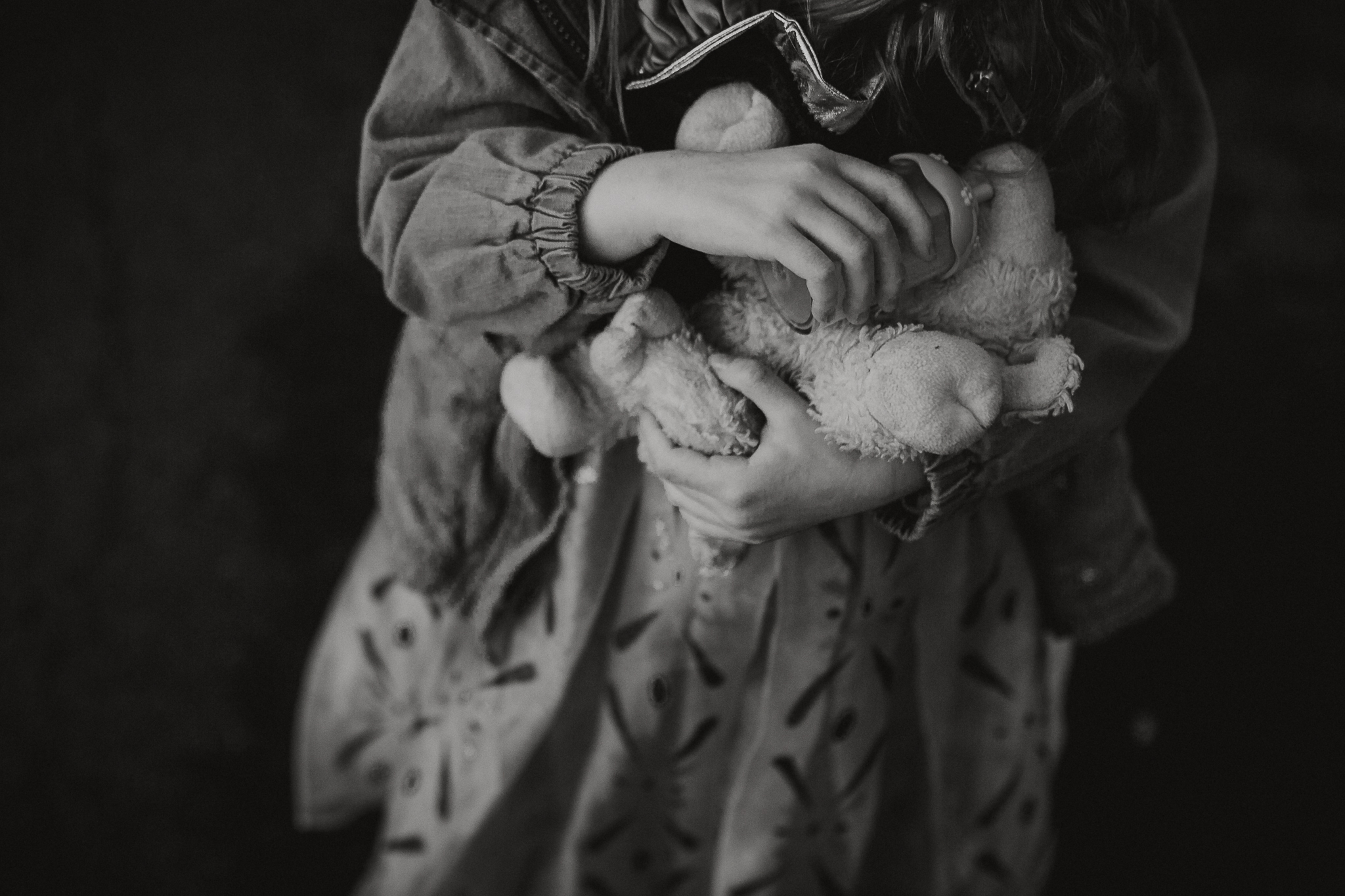 black and white hands bottle details stuffed animal lamb childhood lifestyle documentary Ashburn Virginia Marti Austin Photography