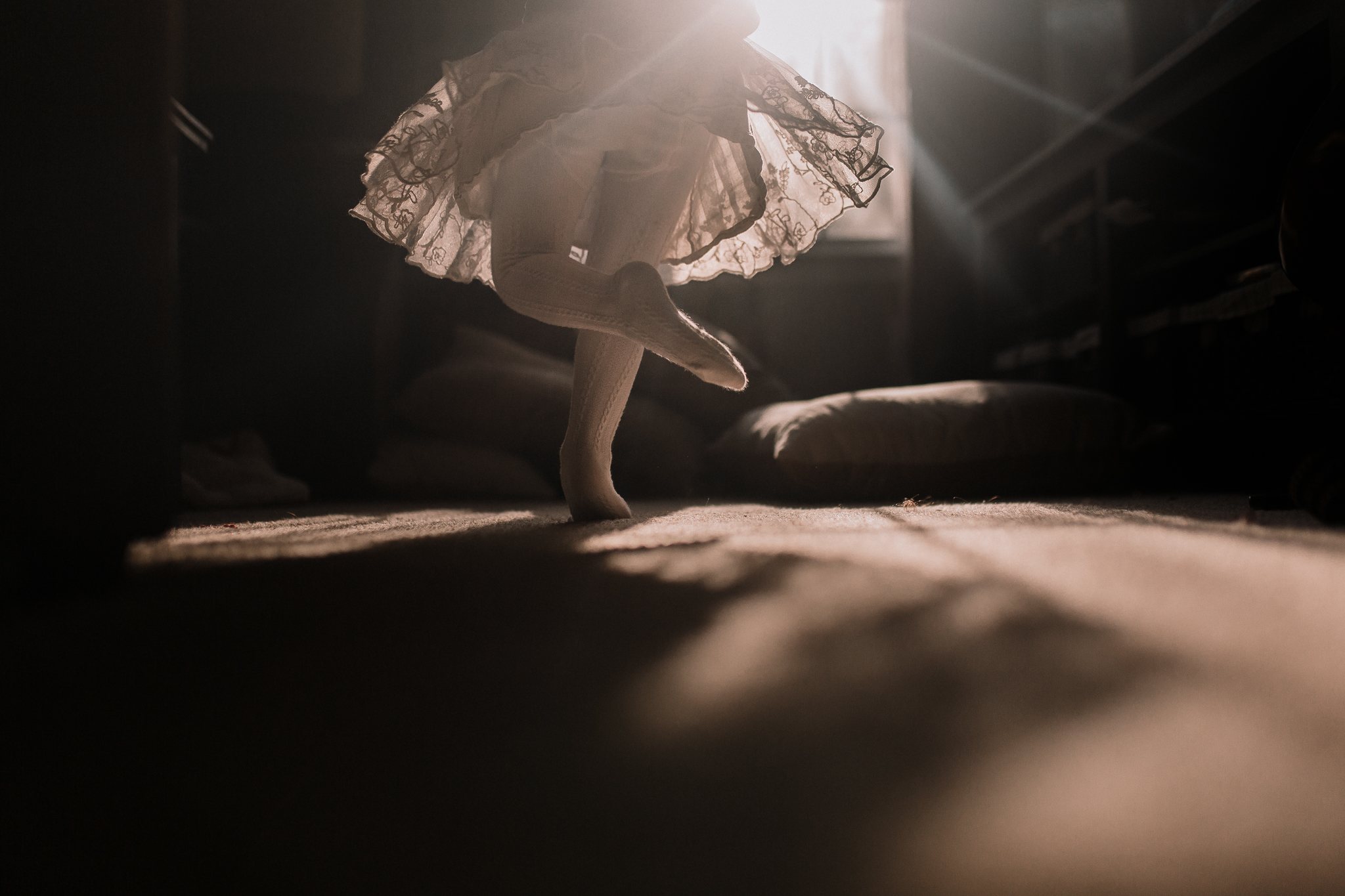 girl twirl skirt light starburst childhood lifestyle documentary Ashburn Virginia Marti Austin Photography