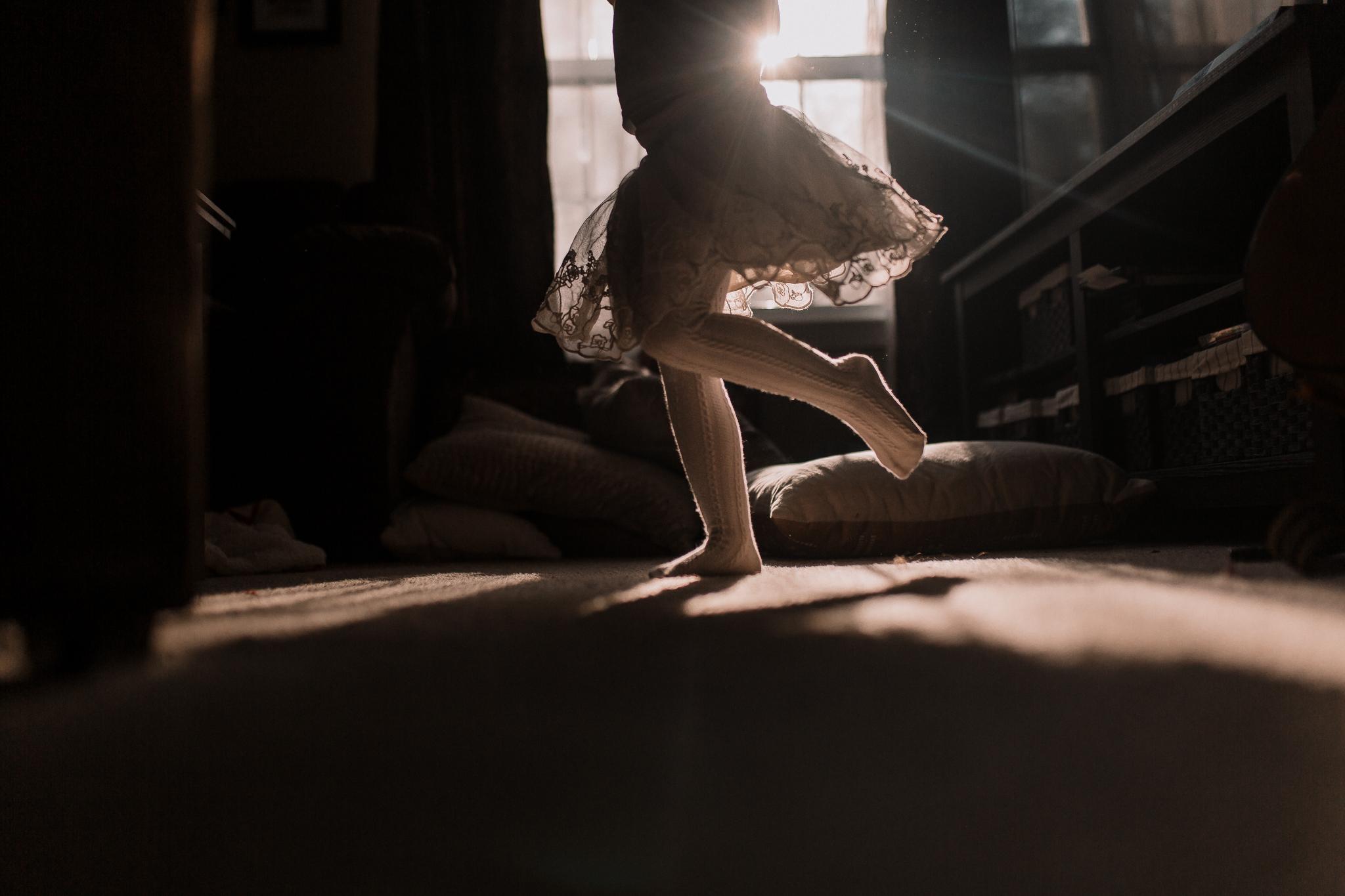girl twirl skirt movement light starburst childhood lifestyle documentary Ashburn Virginia Marti Austin Photography