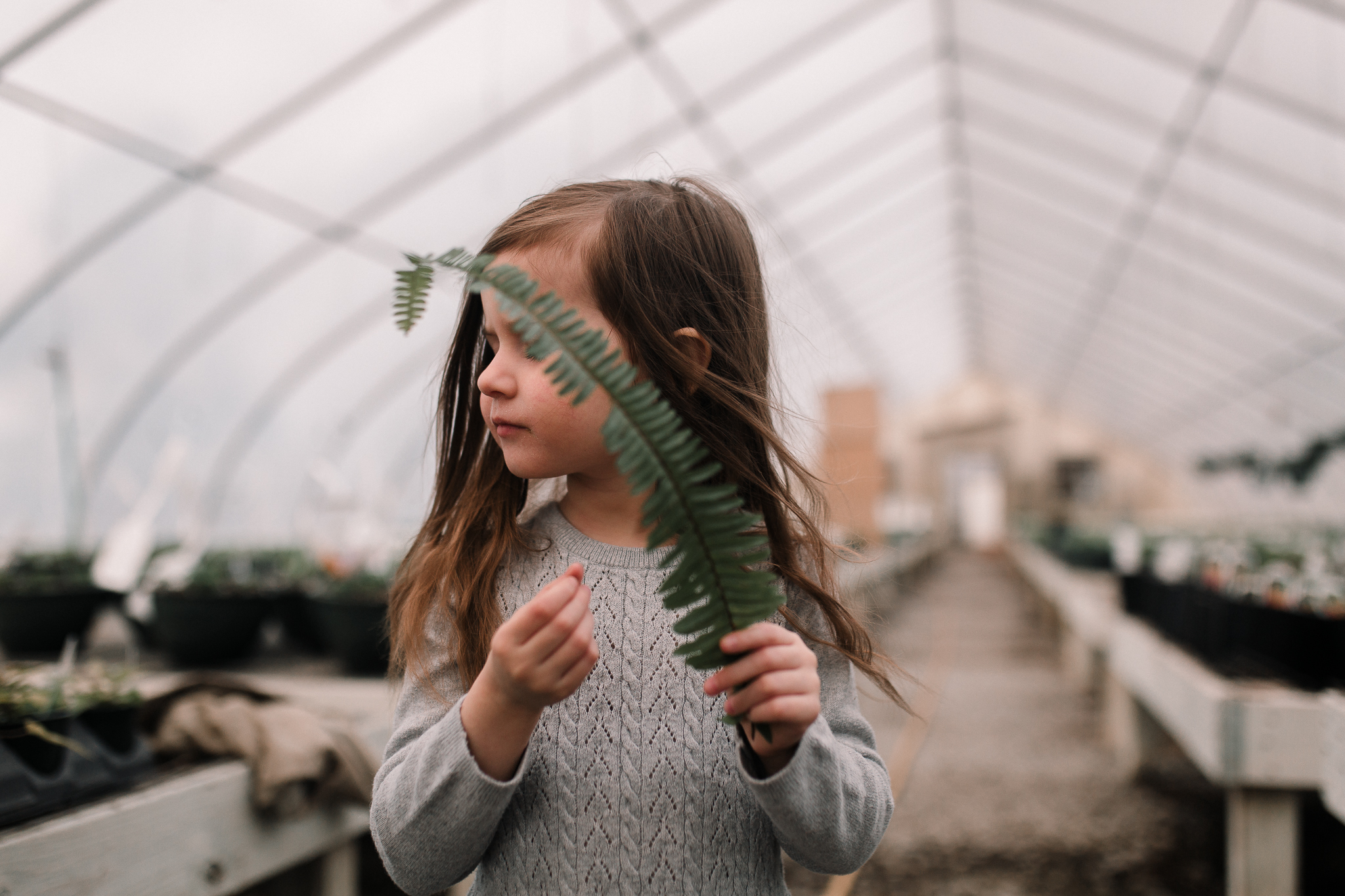 girl greenhouse fern leaf outdoor lifestyle documentary family Ashburn Loudoun northern Virginia  childhood Marti Austin Photography