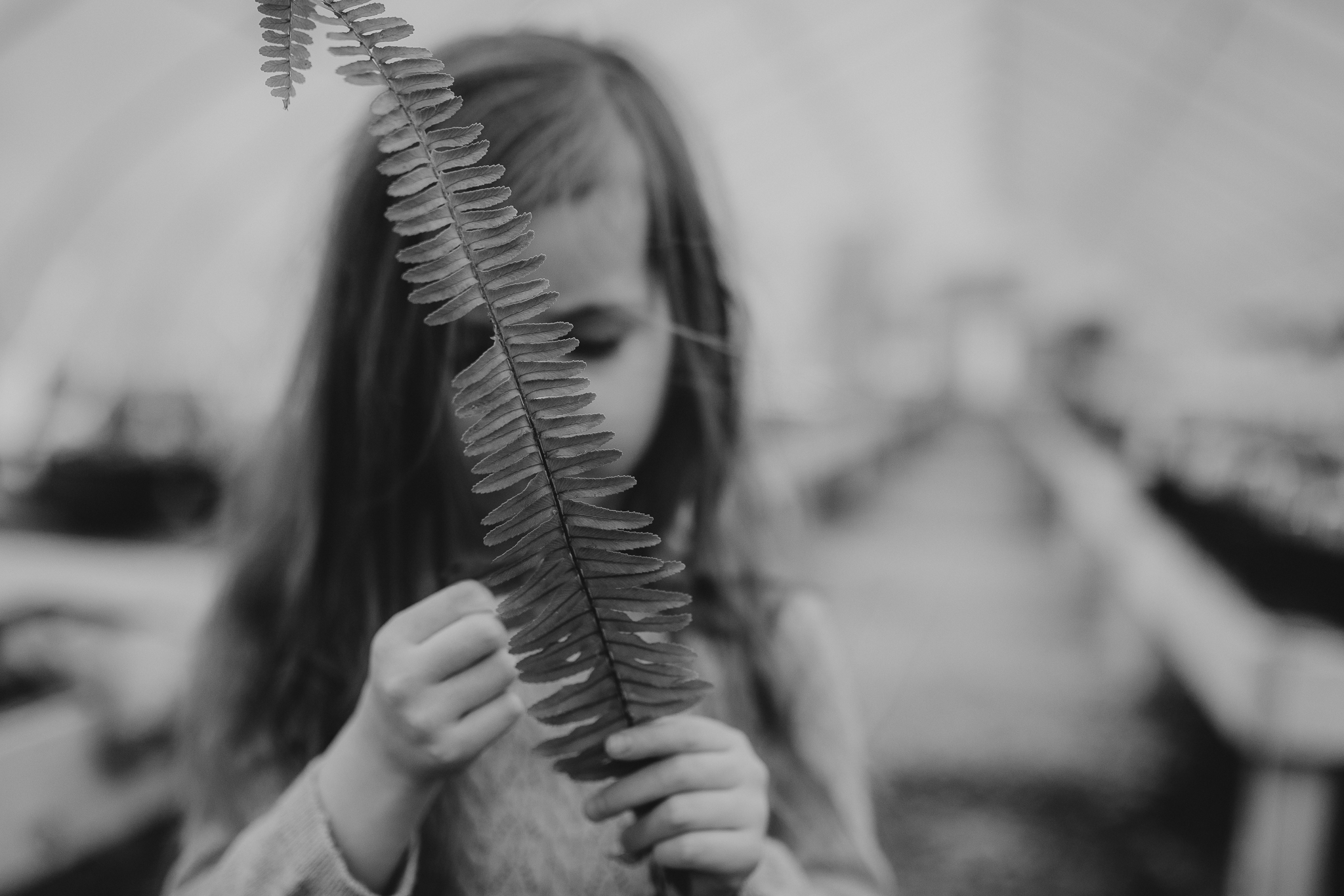 black and white portrait leaf fern plant greenhouse hands details lifestyle documentary family Ashburn Loudoun northern Virginia  childhood Marti Austin Photography