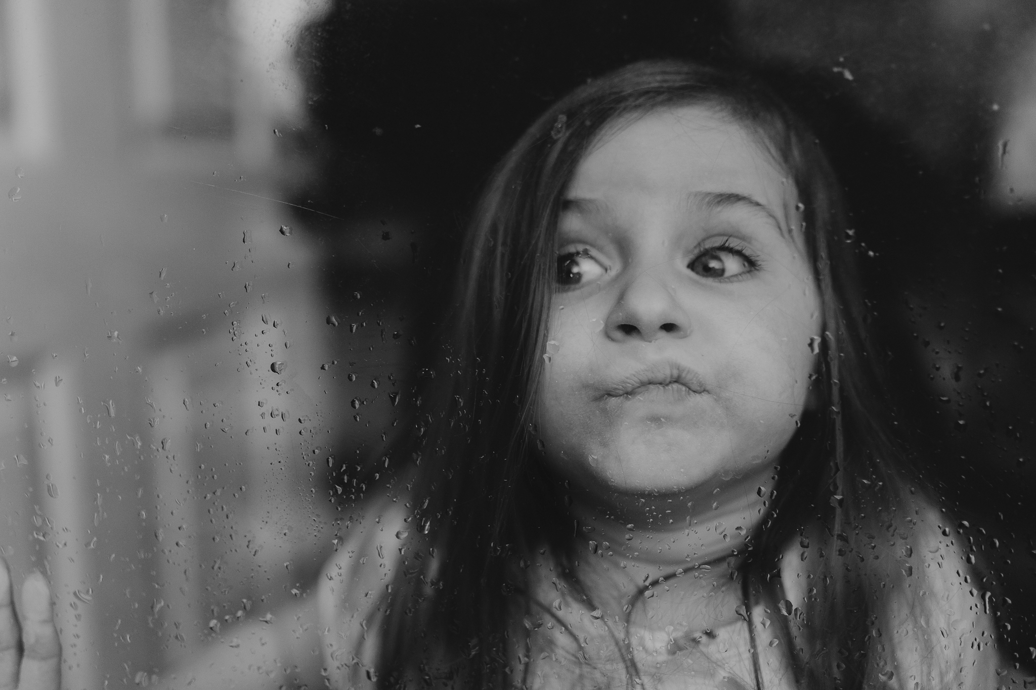 black and white girl with face against glass lifestyle documentary family Ashburn Loudoun northern Virginia  childhood Marti Austin Photography