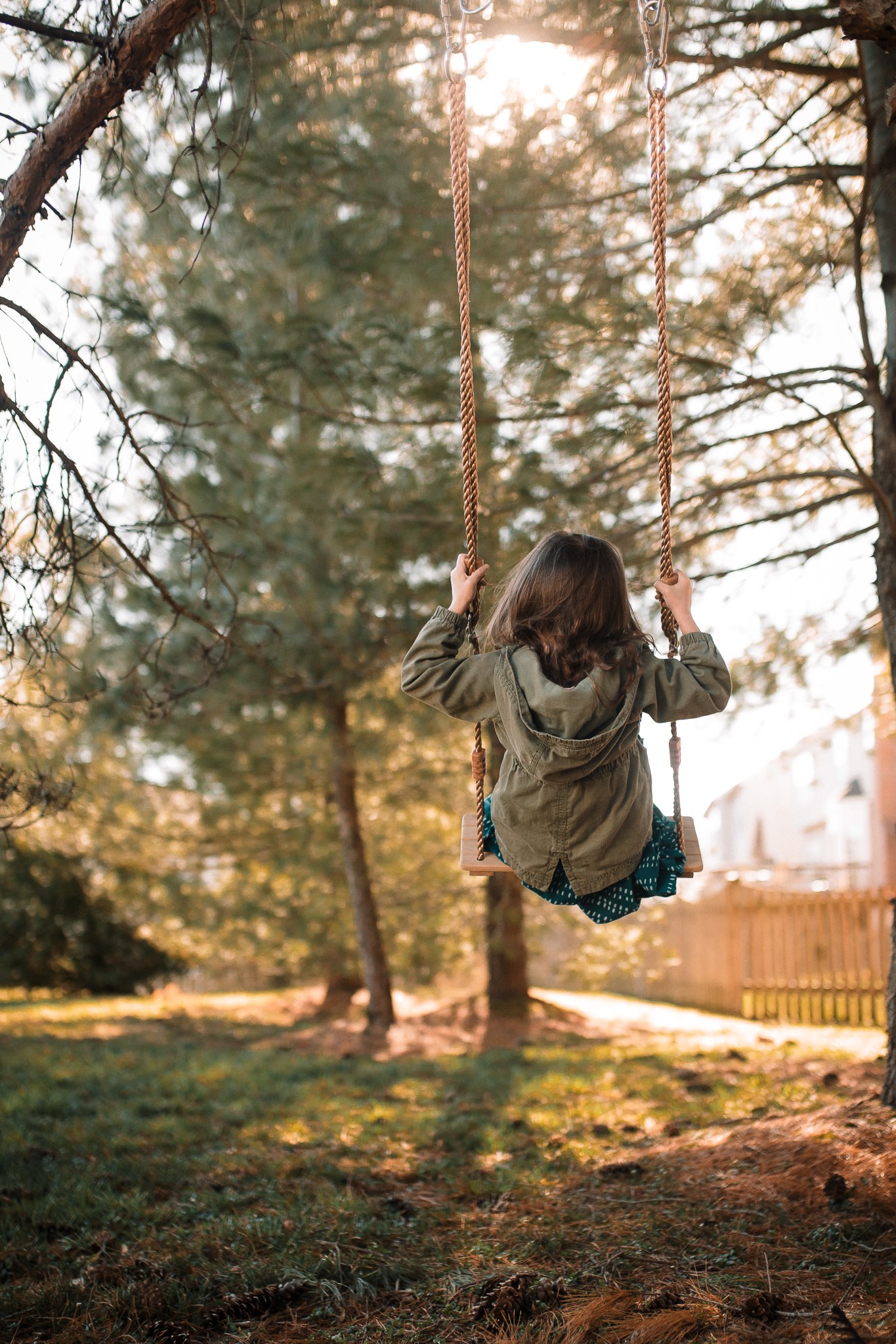girl swinging from tree at golden hour lifestyle documentary family Ashburn Loudoun northern Virginia  childhood Marti Austin Photography