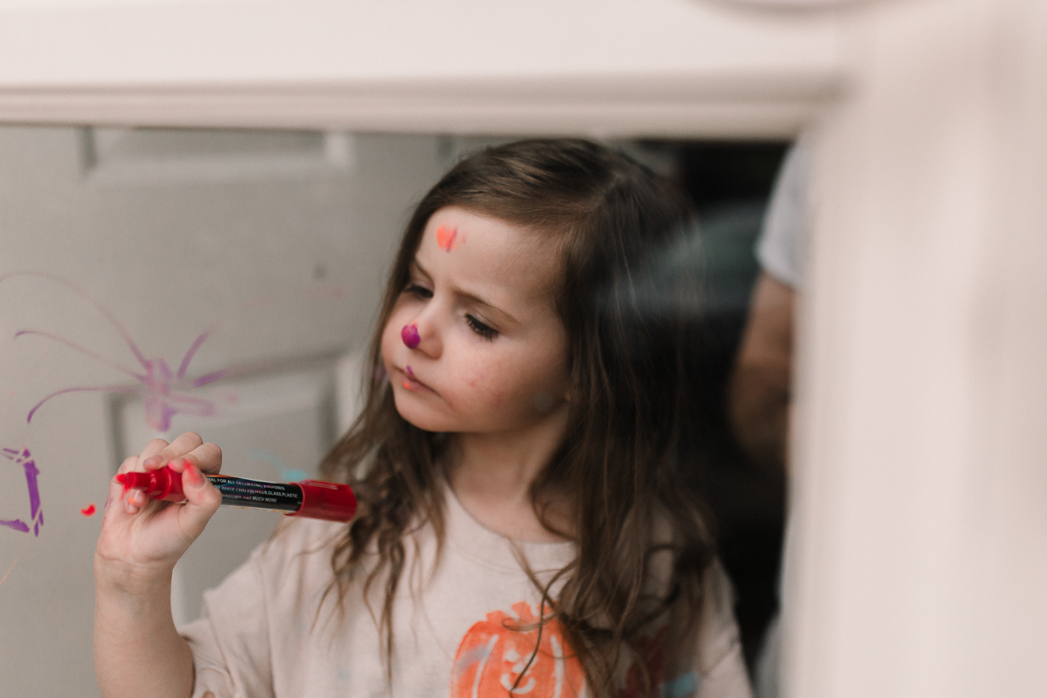 girl glass door drawing face paint lifestyle documentary family childhood Ashburn Loudoun Northern Virginia Marti Austin Photography