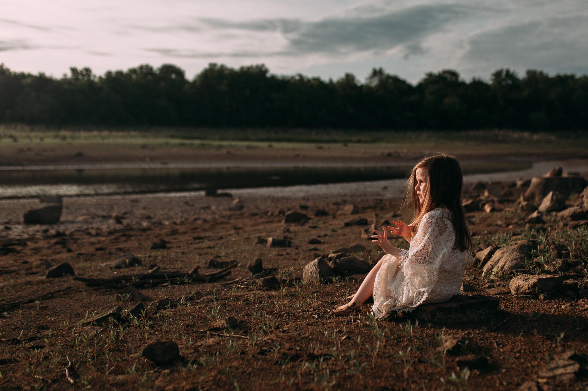 girl sitting on beach watching sunset golden hour Beaverdam Reservoir lifestyle documentary family Ashburn Loudoun Northern Virginia Marti Austin Photography