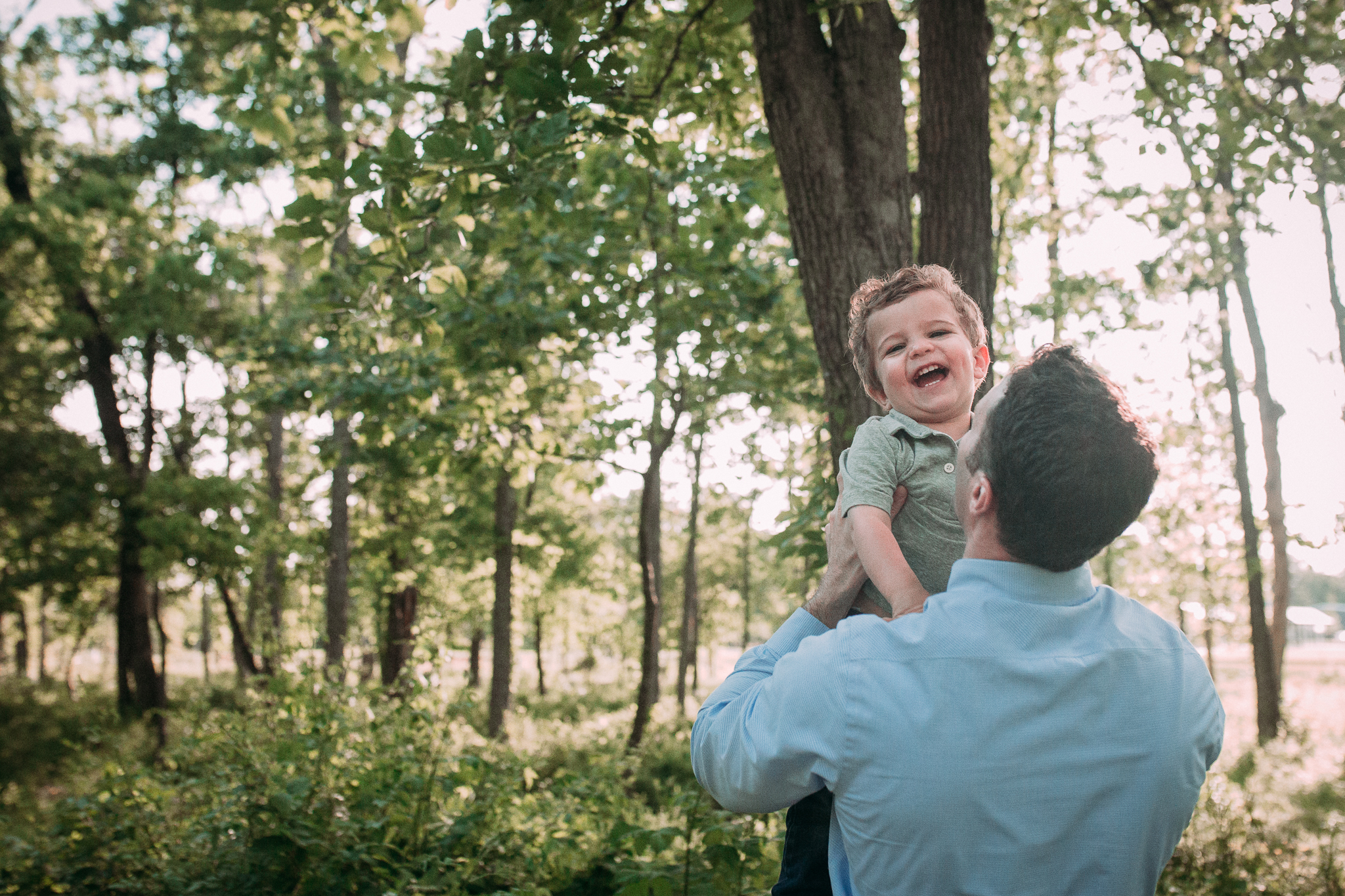 father son throwing laughing outdoor sunset golden hour The Barn at One Loudoun Ashburn Northern Virginia Liifestyle Documentary Family Marti Austin Photography