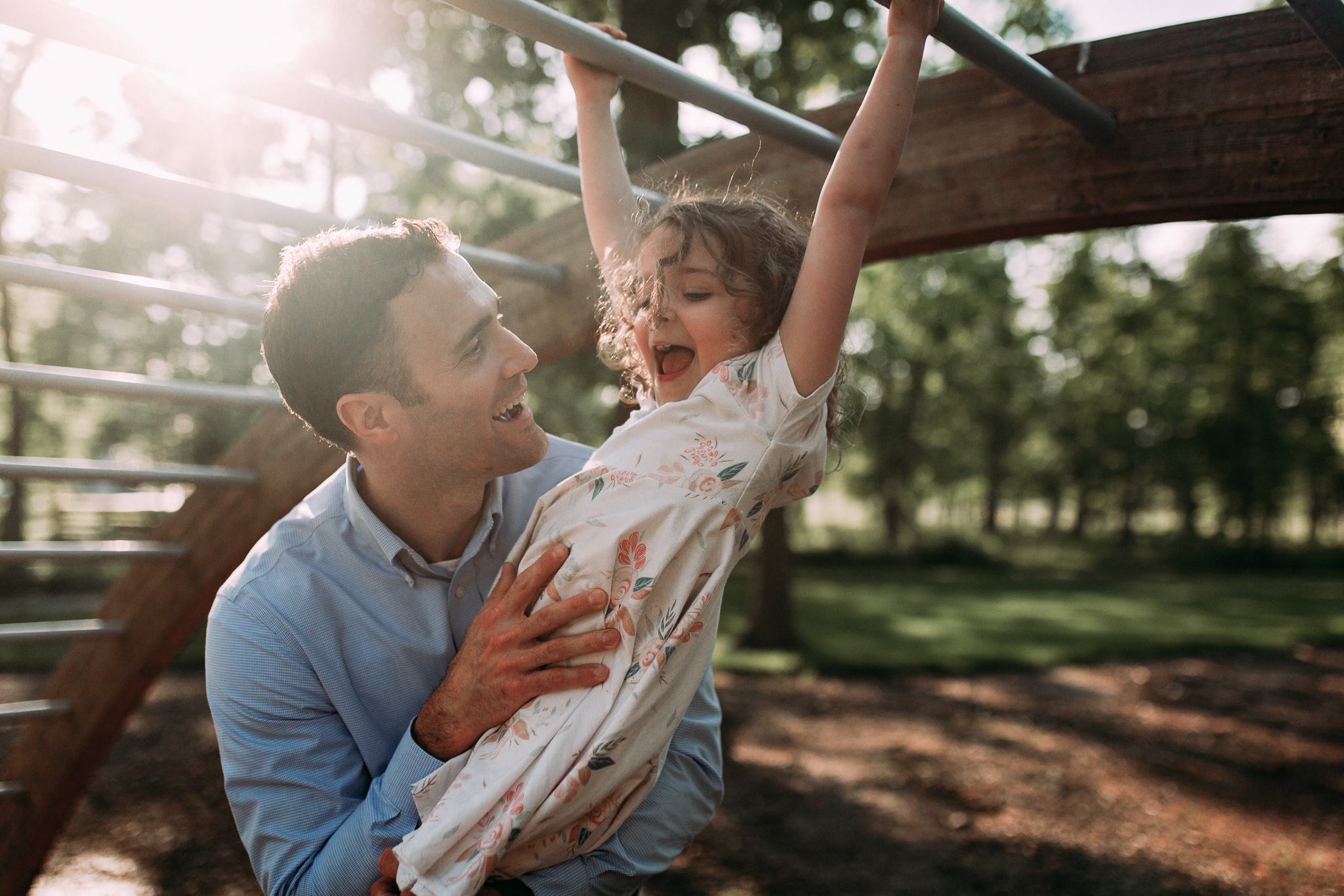 dad helping daughter jungle gym outdoor sunset golden hour The Barn at One Loudoun Ashburn Northern Virginia Liifestyle Documentary Family Marti Austin Photography