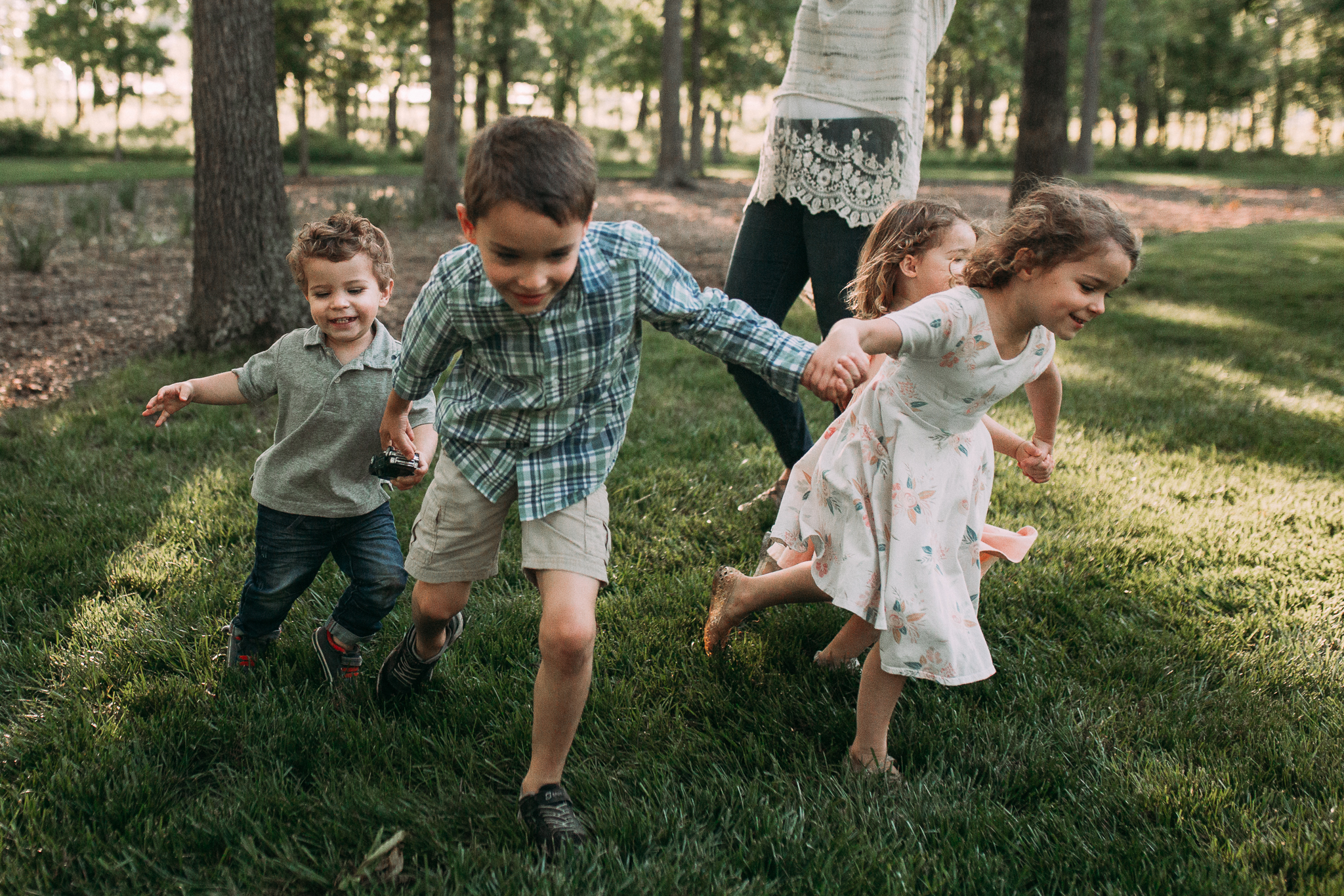 kids siblings running outdoor sunset golden hour The Barn at One Loudoun Ashburn Northern Virginia Liifestyle Documentary Family Marti Austin Photography