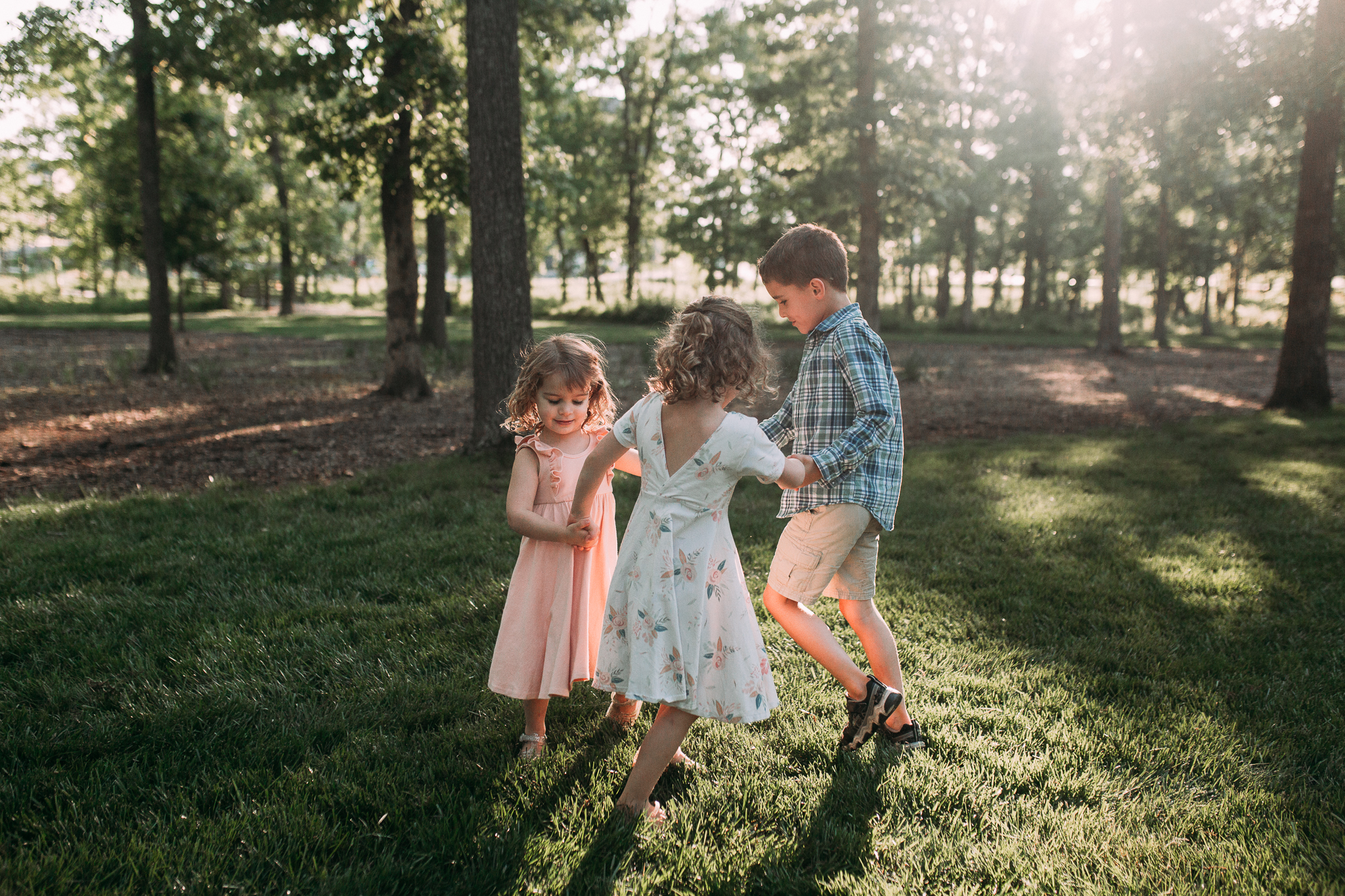 kids siblings ring around the rosy outdoor sunset golden hour The Barn at One Loudoun Ashburn Northern Virginia Liifestyle Documentary Family Marti Austin Photography