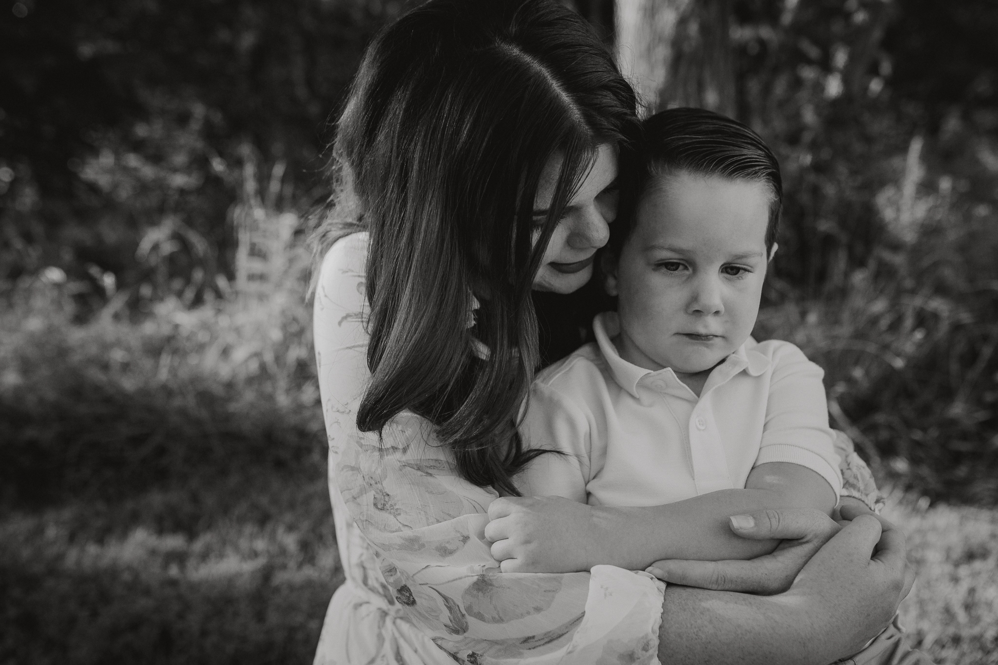 black and white mother son hug Brambleton Beaverdam Reservoir Loudoun Virginia Lifestyle Documentary Family Marti Austin Photography