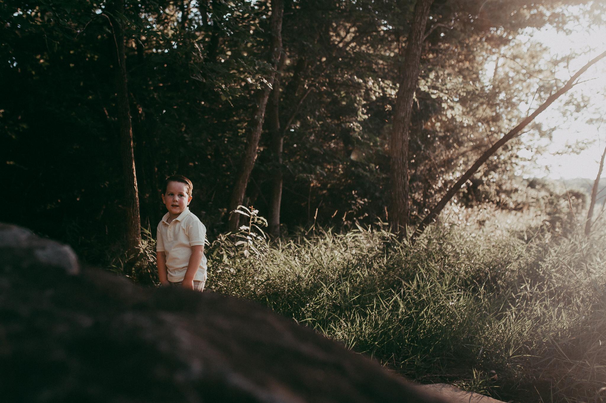 boy in the woods at sunset  Brambleton Beaverdam Reservoir Loudoun Virginia Lifestyle Documentary Family Marti Austin Photography