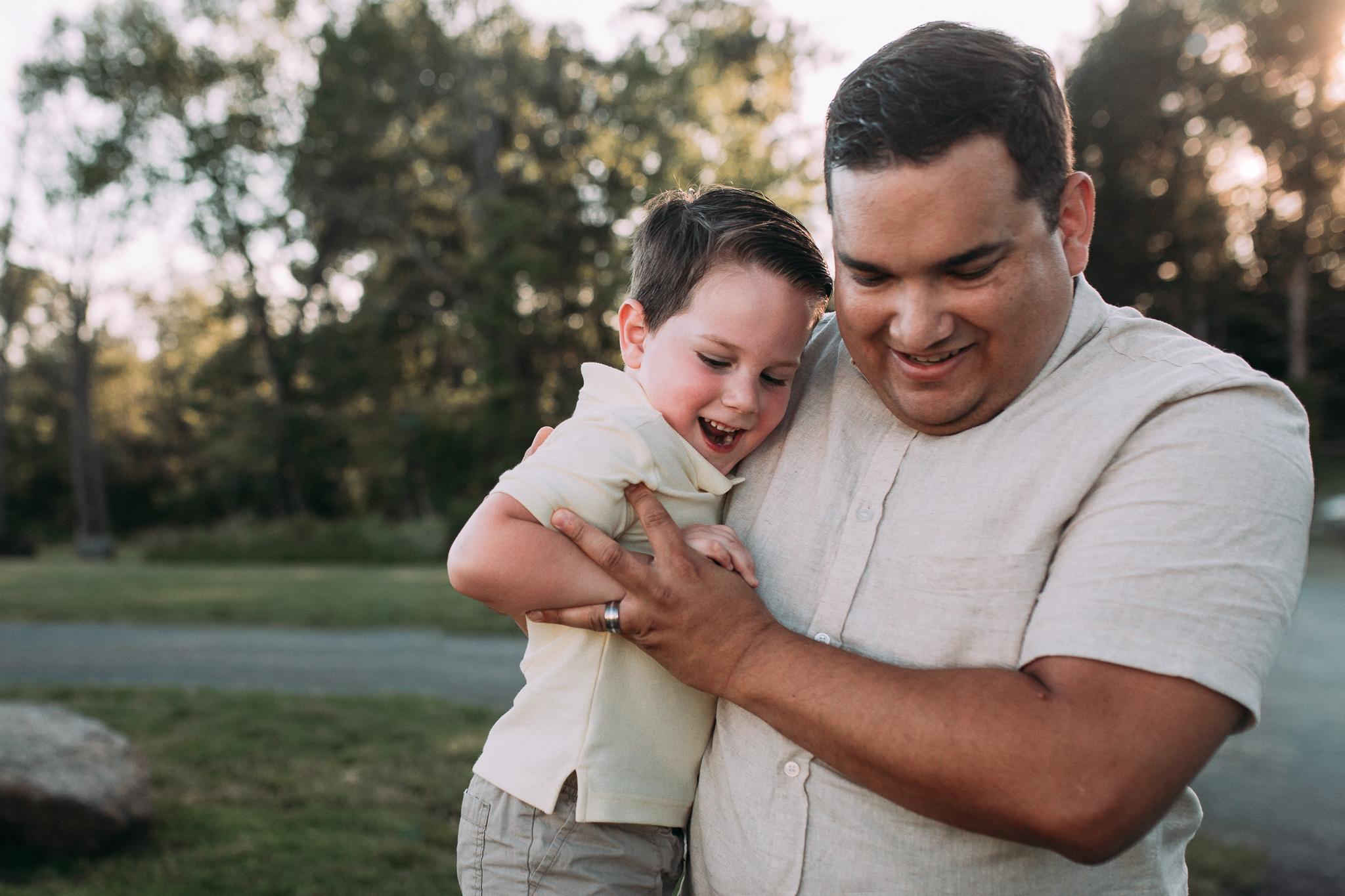 father son laugh hug giggle  Brambleton Beaverdam Reservoir Loudoun Virginia Lifestyle Documentary Family Marti Austin Photography sunset golden hour