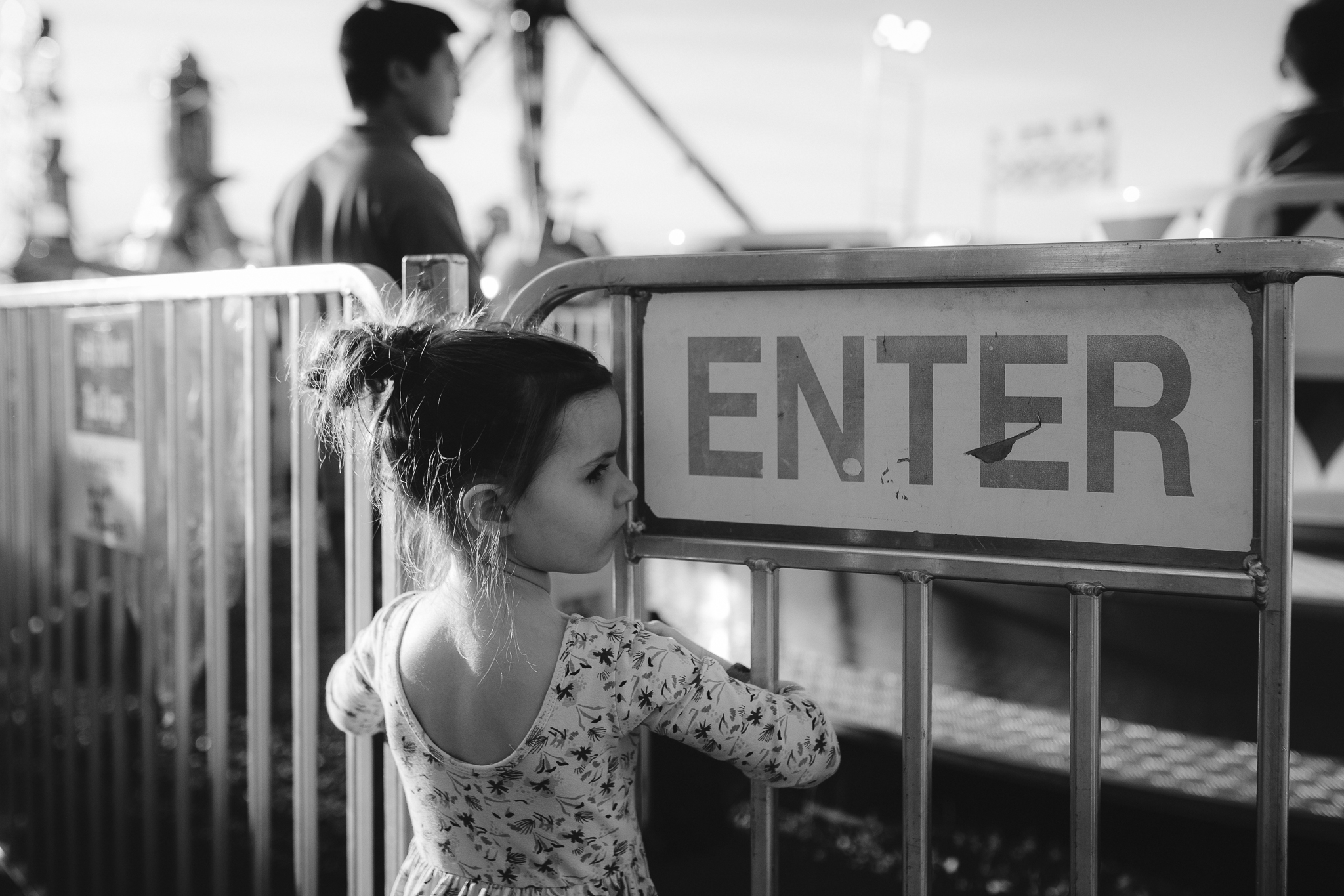 black and white enter sign carnival ride girl waiting summer Ashburn Loudoun Northern Virginia family lifestyle documentary childhood Marti Austin Photography