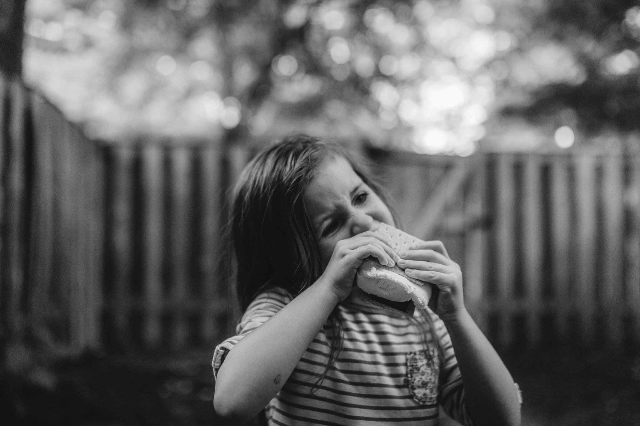 black and white girl eating smores summer Ashburn Loudoun Northern Virginia family lifestyle documentary childhood Marti Austin Photography