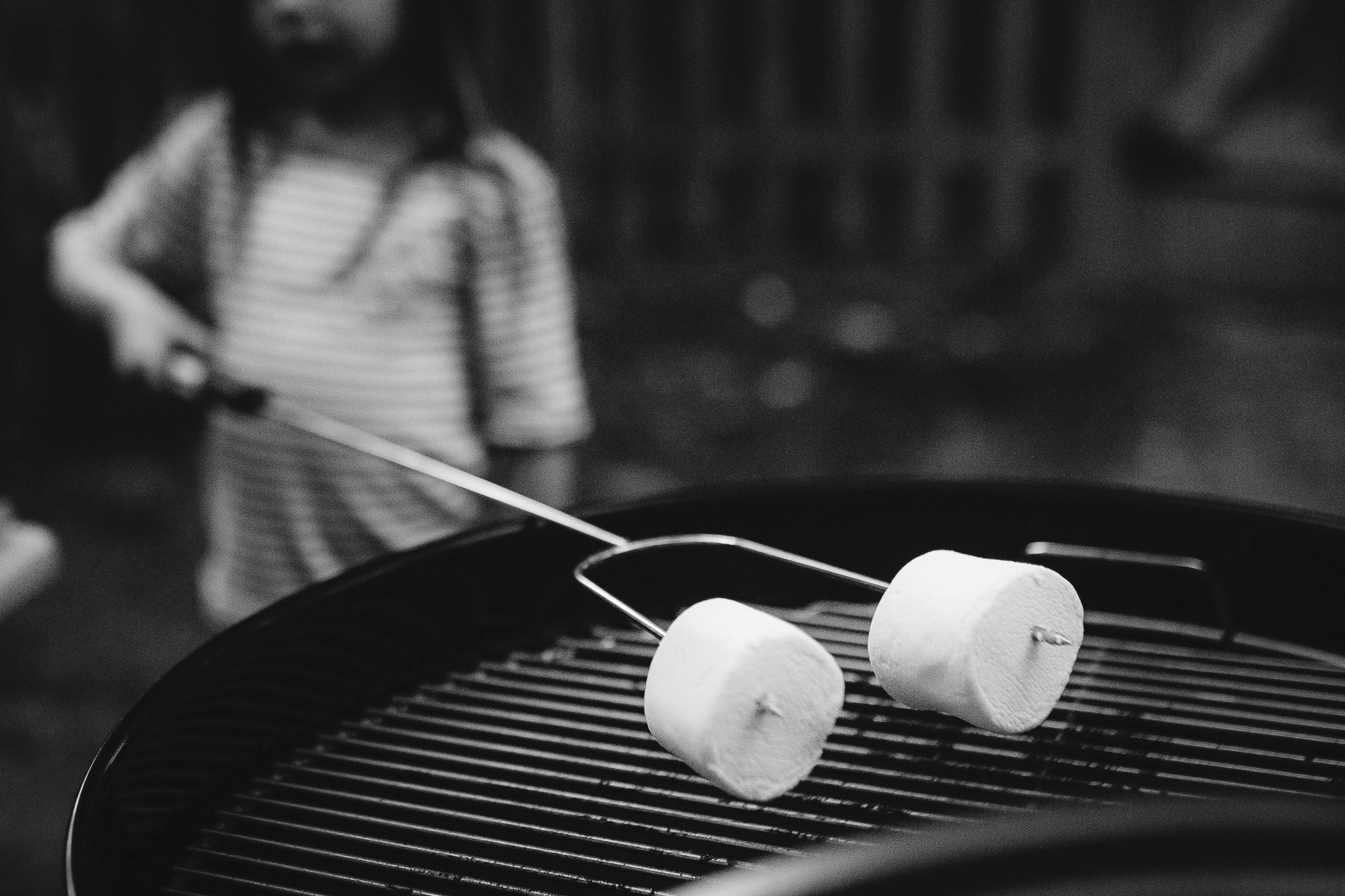 black and white girl roasting marshmallows charcoal grill details smoressummer Ashburn Loudoun Northern Virginia family lifestyle documentary childhood Marti Austin Photography