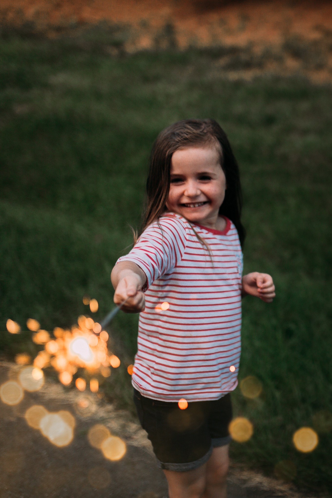 girl playing with sparkler Fourth of July summer Ashburn Loudoun Northern Virginia family lifestyle documentary childhood Marti Austin Photography
