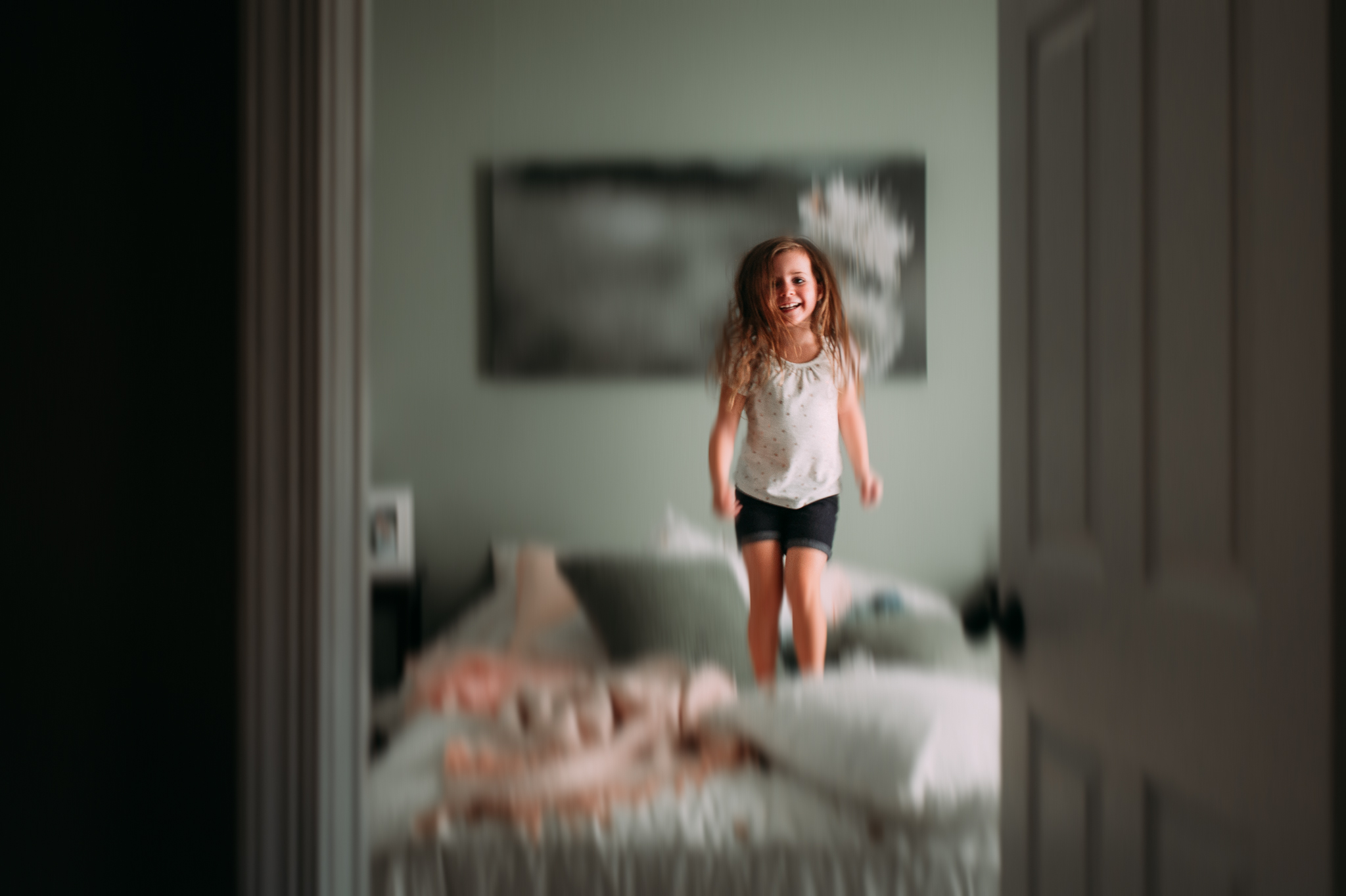 girl jumping on bed motion panning movement summer Ashburn Loudoun Northern Virginia family lifestyle documentary childhood Marti Austin Photography
