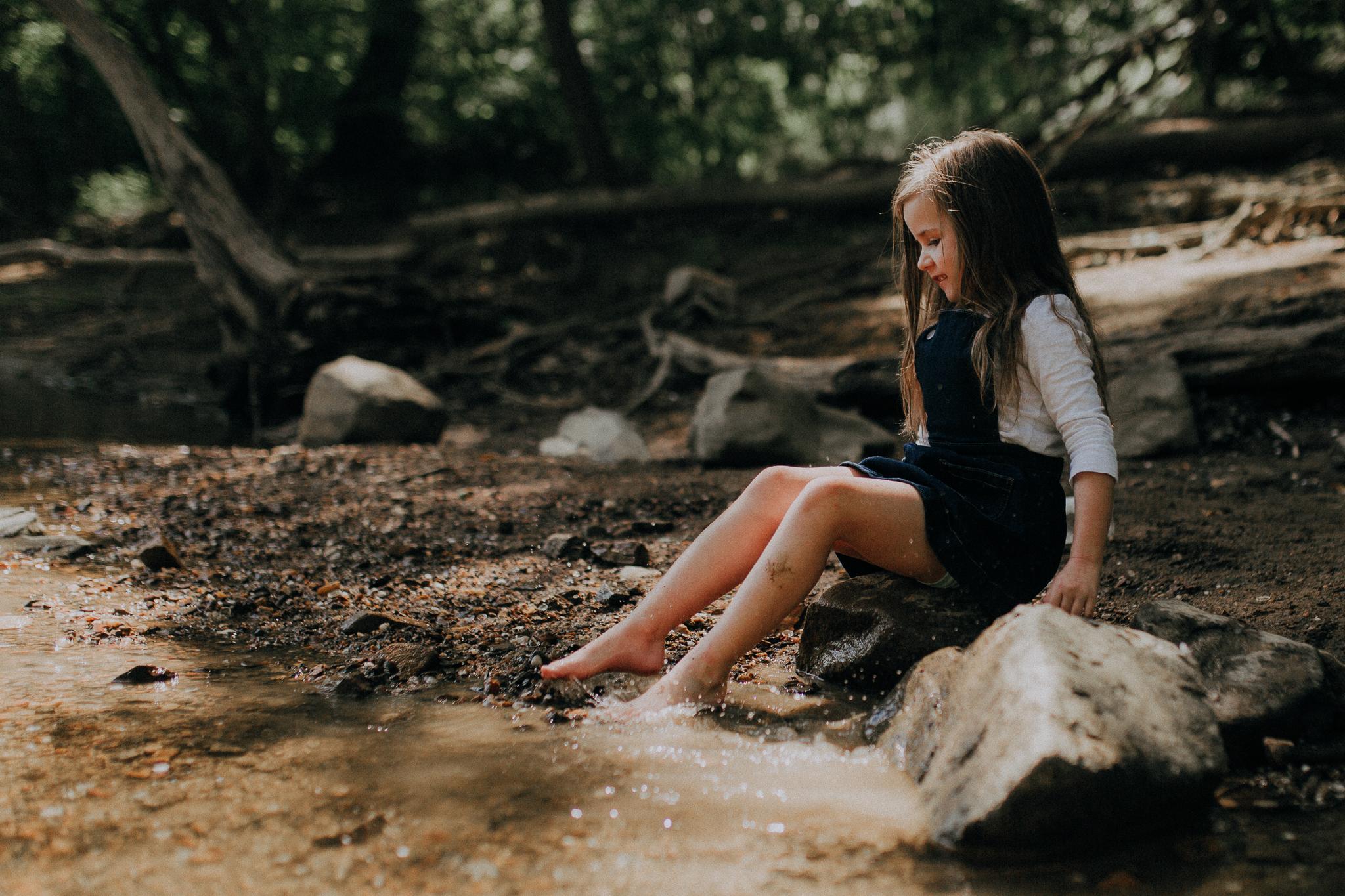 girl sitting splashing in creek Kephart Bridge Landing summer Ashburn Loudoun Northern Virginia family lifestyle documentary childhood Marti Austin Photography