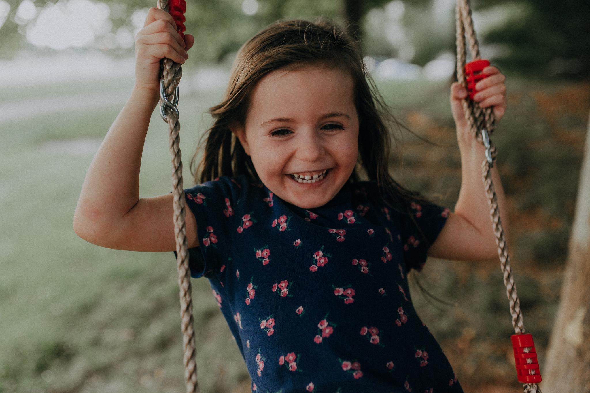girl on swing laughing summer Ashburn Loudoun Northern Virginia family lifestyle documentary childhood Marti Austin Photography
