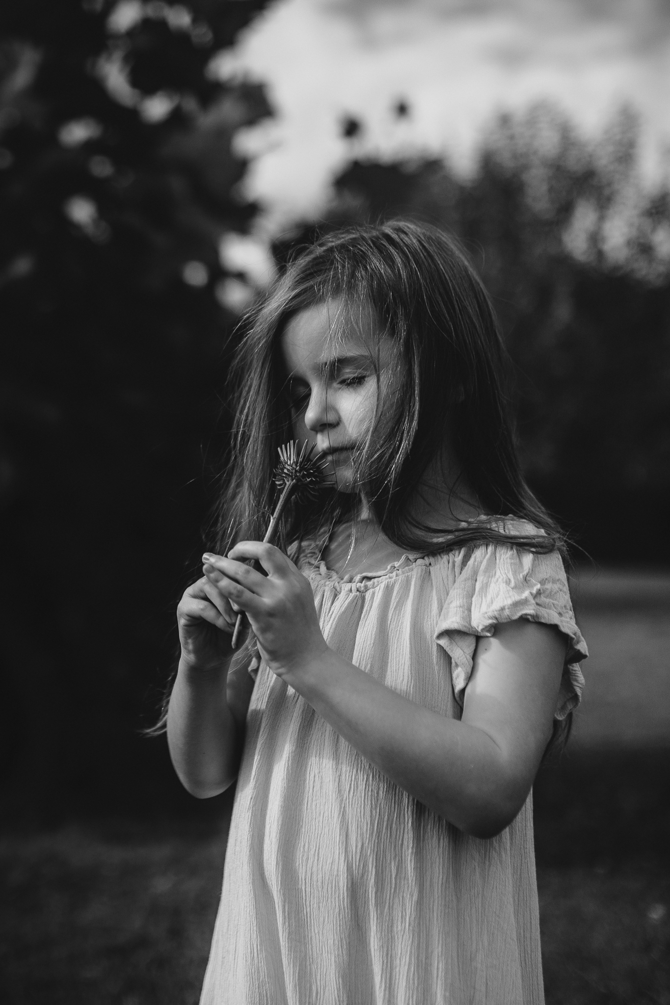 Black and white girl smelling a flower summer Ashburn Loudoun Northern Virginia family lifestyle documentary childhood Marti Austin Photography