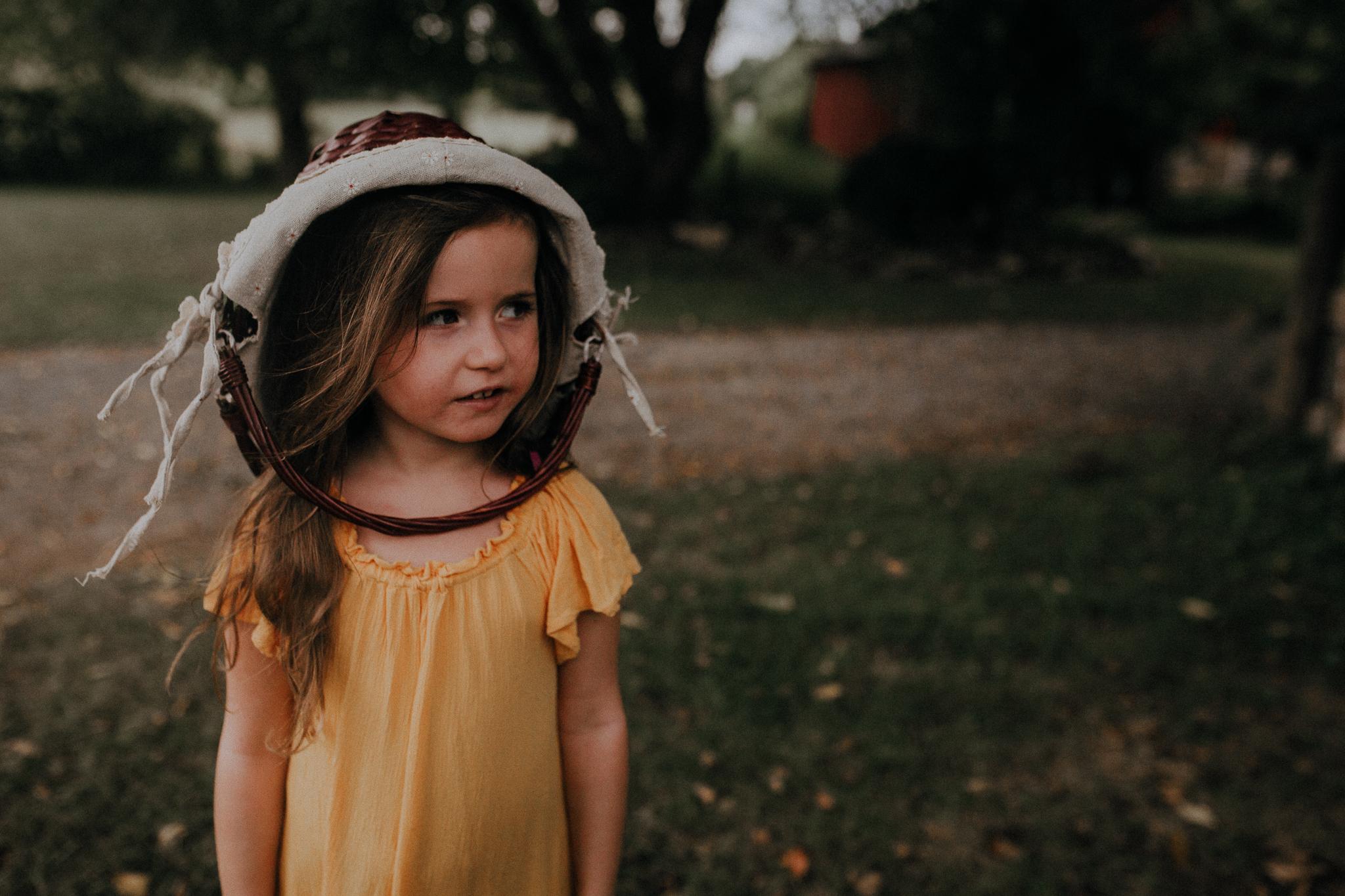 girl wearing basket on head like a hat summer Ashburn Loudoun Northern Virginia family lifestyle documentary childhood Marti Austin Photography