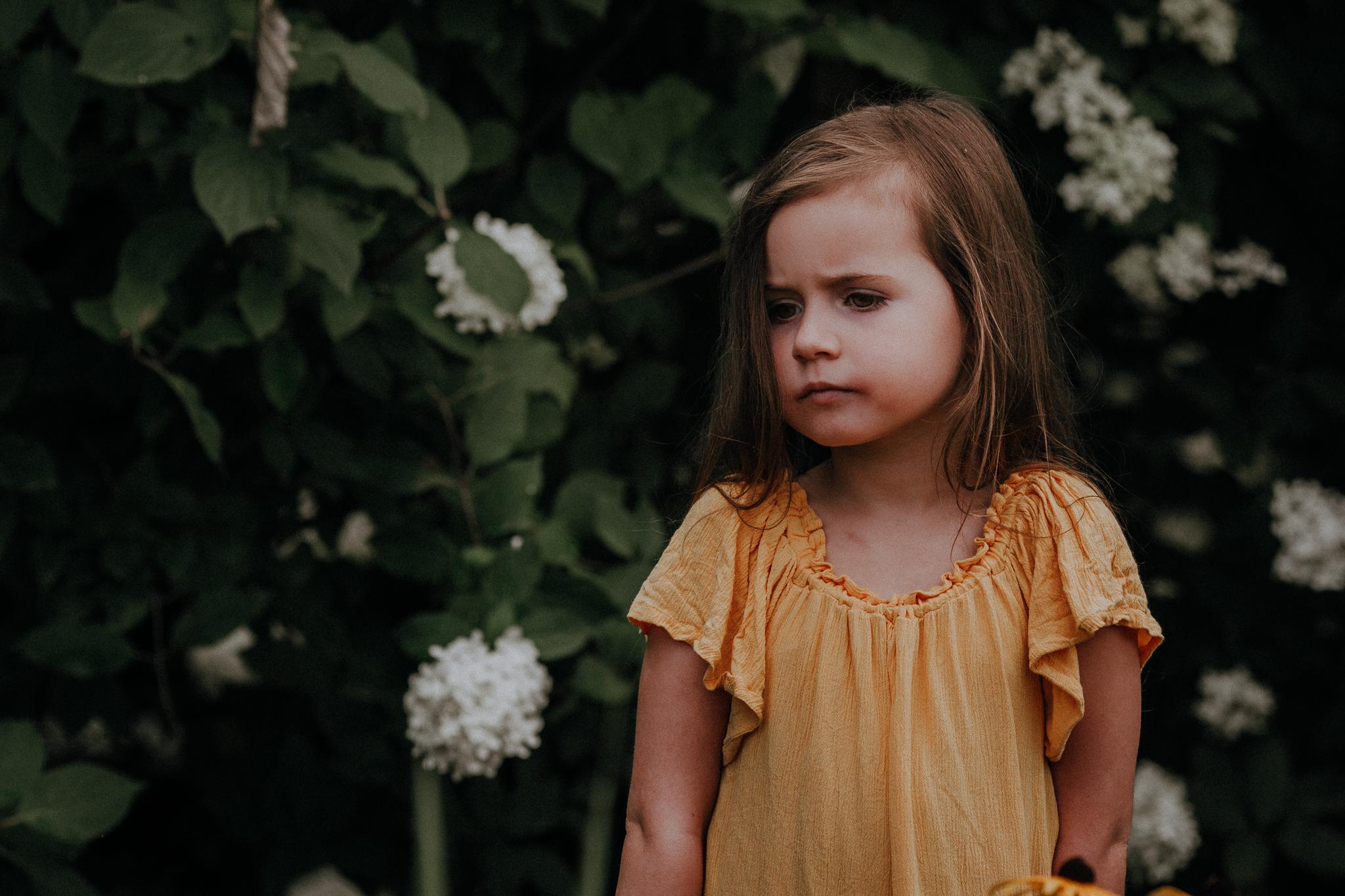 portrait of a girl in yellow dress white hydrangeas summer Ashburn Loudoun Northern Virginia family lifestyle documentary childhood Marti Austin Photography