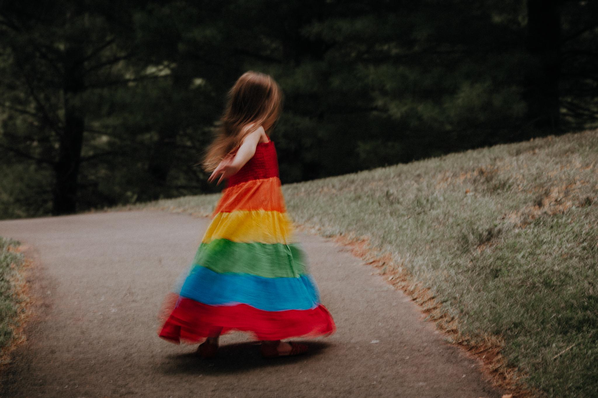 girl twirling in rainbow dress movement motion summer Ashburn Loudoun Northern Virginia family lifestyle documentary childhood Marti Austin Photography