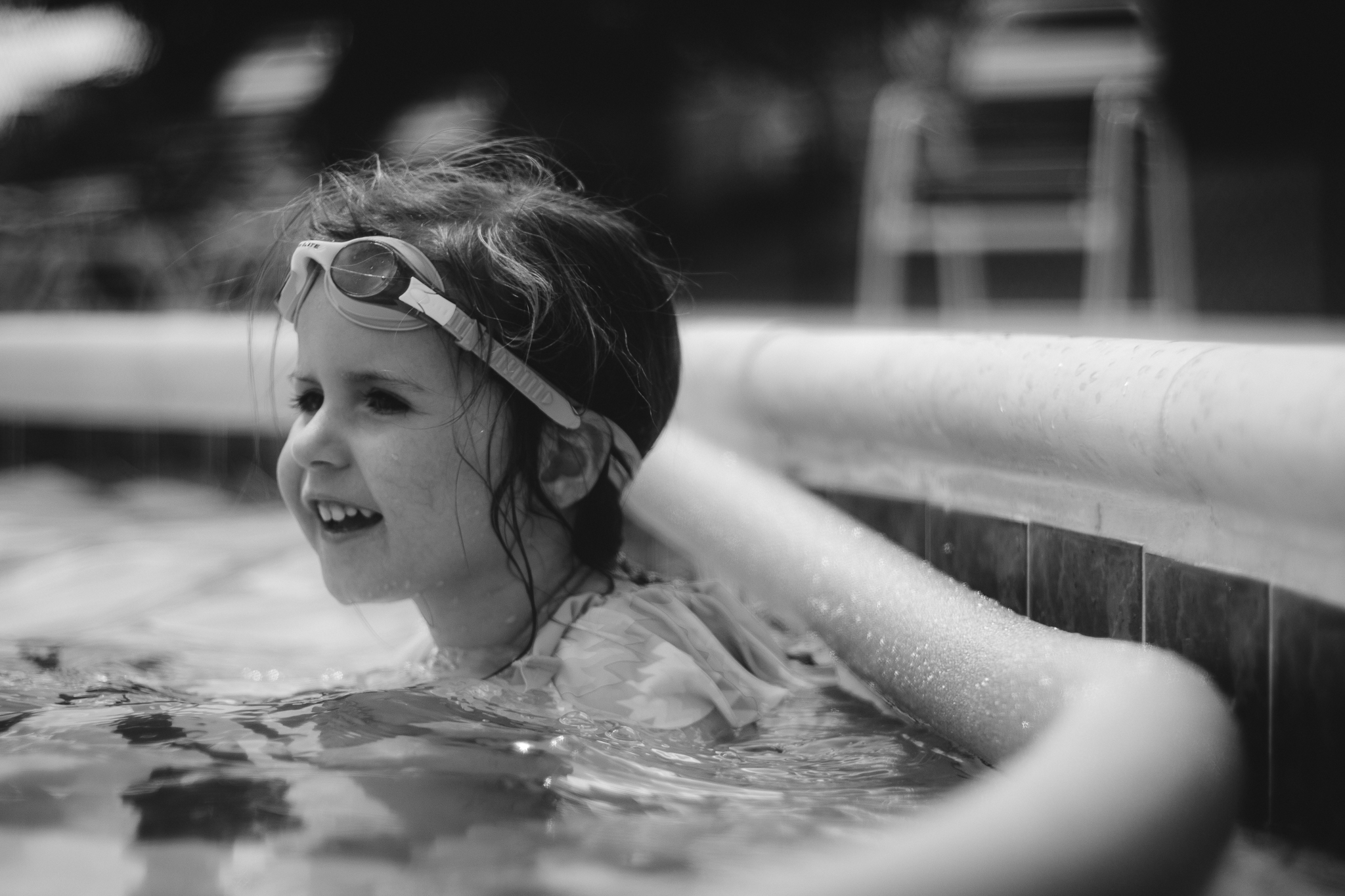 black and white portrait of girl in pool summer Ashburn Loudoun Northern Virginia family lifestyle documentary childhood Marti Austin Photography
