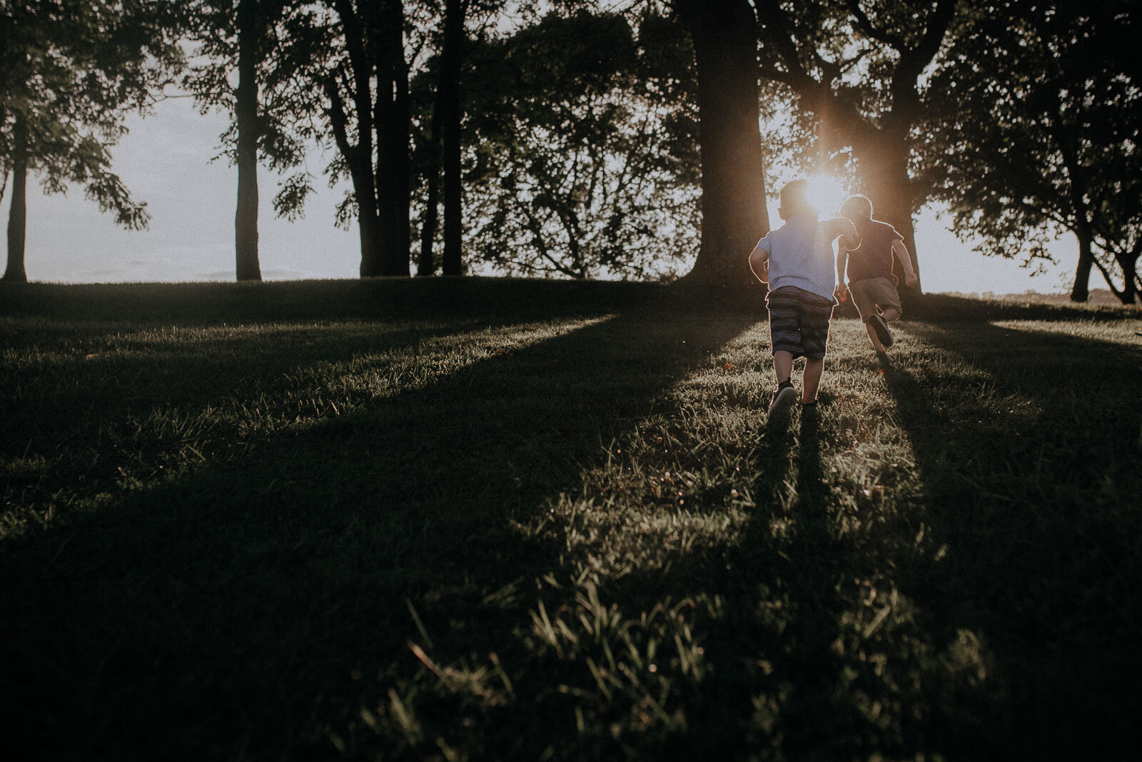 two boys brothers running into sunset brothers Ida Lee Leesburg Loudoun Virginia Lifestyle Documentary Maternity Family Marti Austin Photography