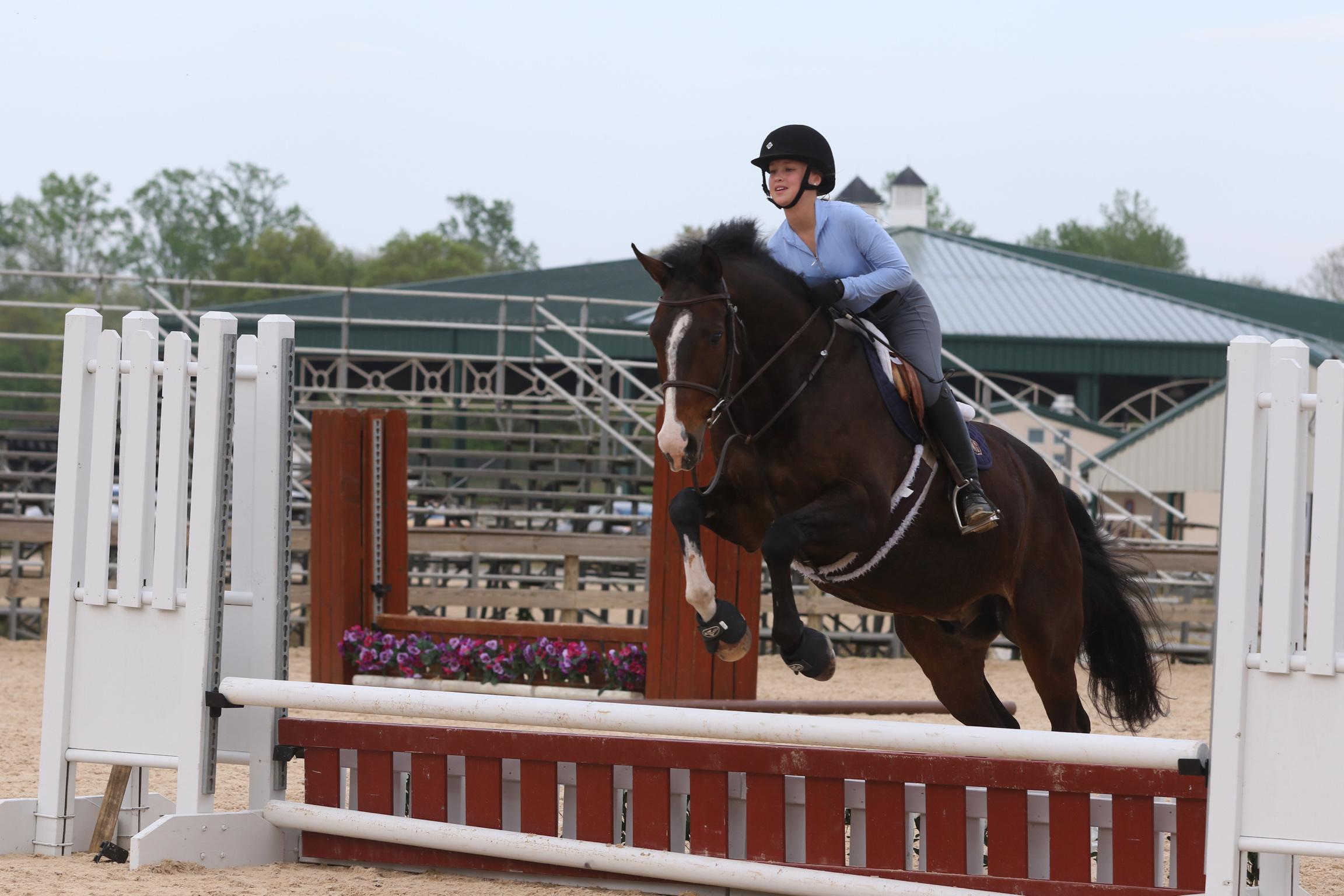 Lindsey jumping charisma.JPG