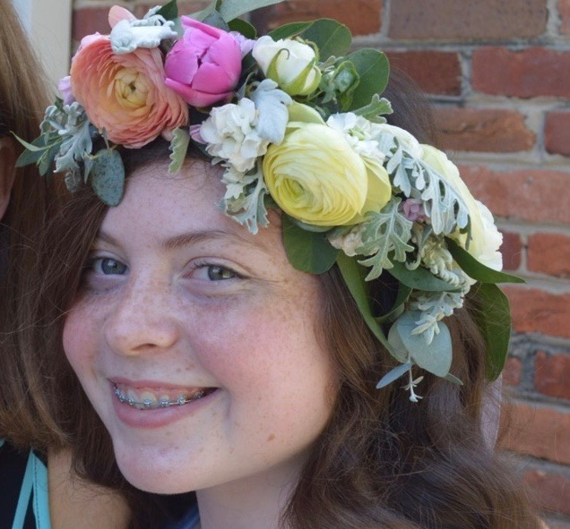 Flower girl head piece of ranunculus and dusty miller leaves