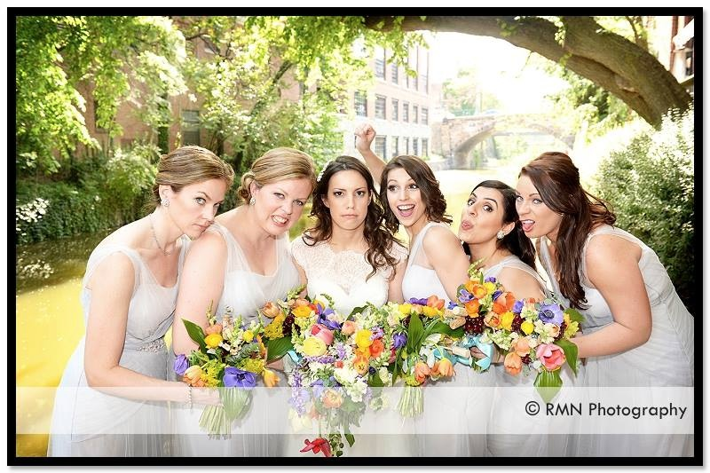 a nutty bunch of bridesmaids and bride and their colorful early spring bouquets